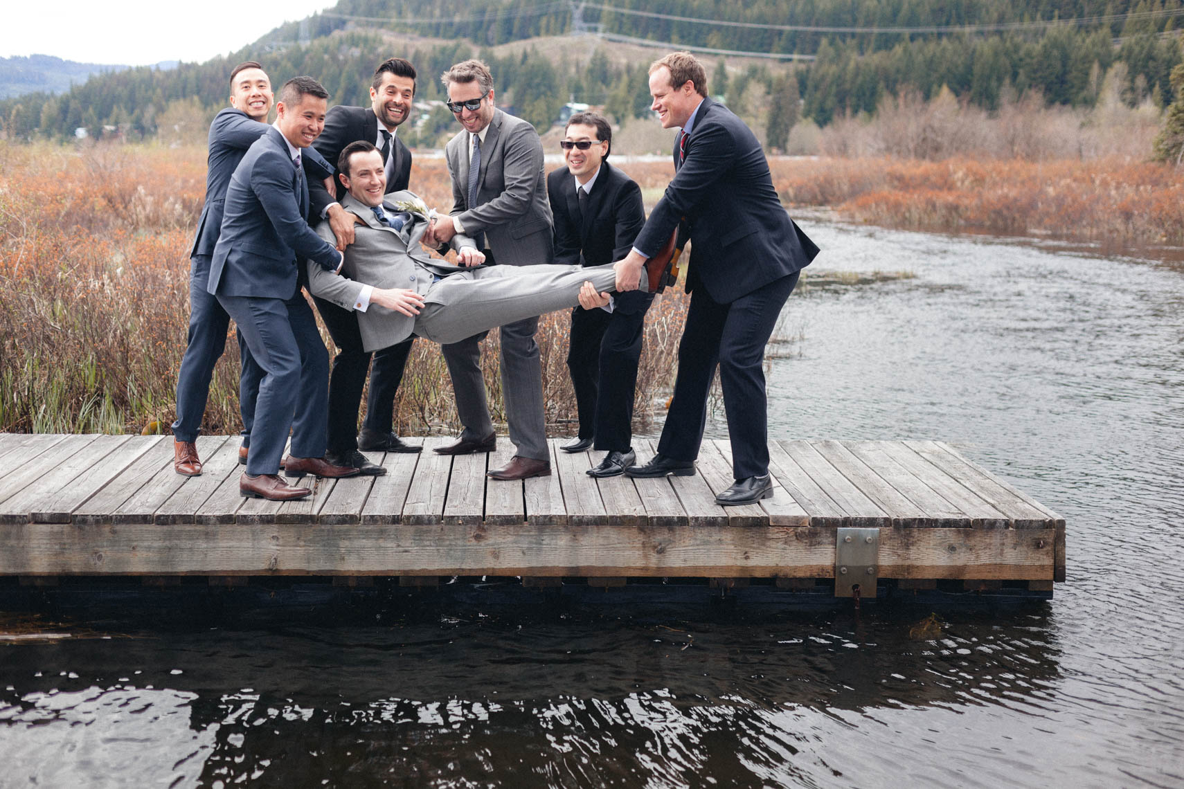 Groom with groomsmen on a dock in Whistler BC