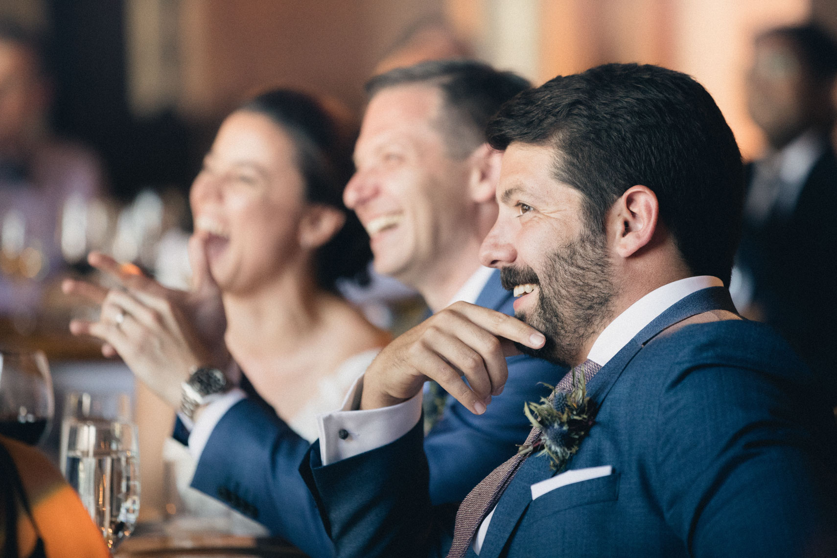 Groomsmen laughing during wedding reception at Banff Springs hotel venue