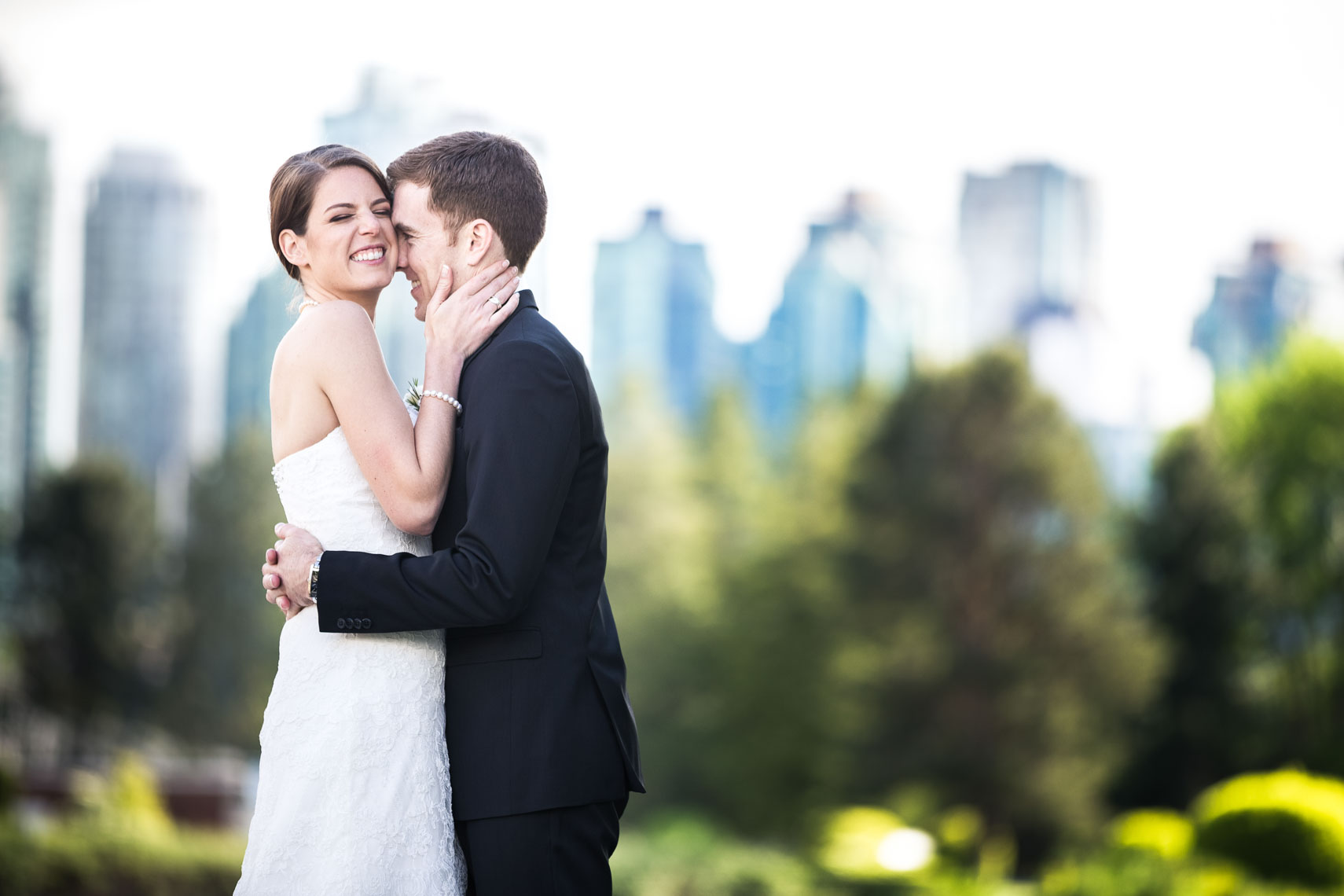 Bride and groom in front of Vancouver skyline