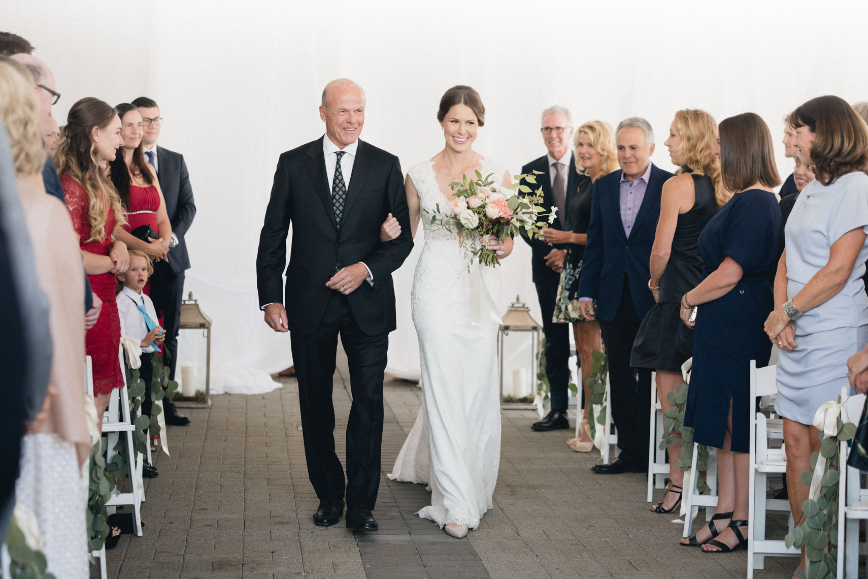 Bride walks down the aisle with her father in Whistler BC