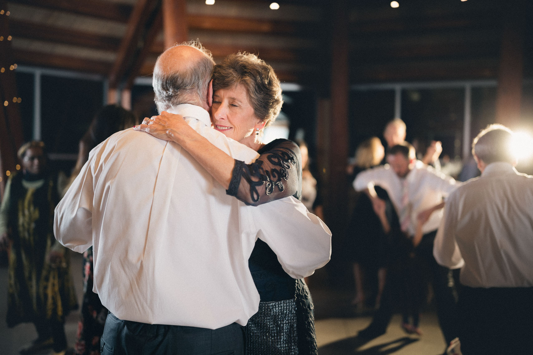 Parents of the bride dance at wedding at the SLCC venue in Whistler.