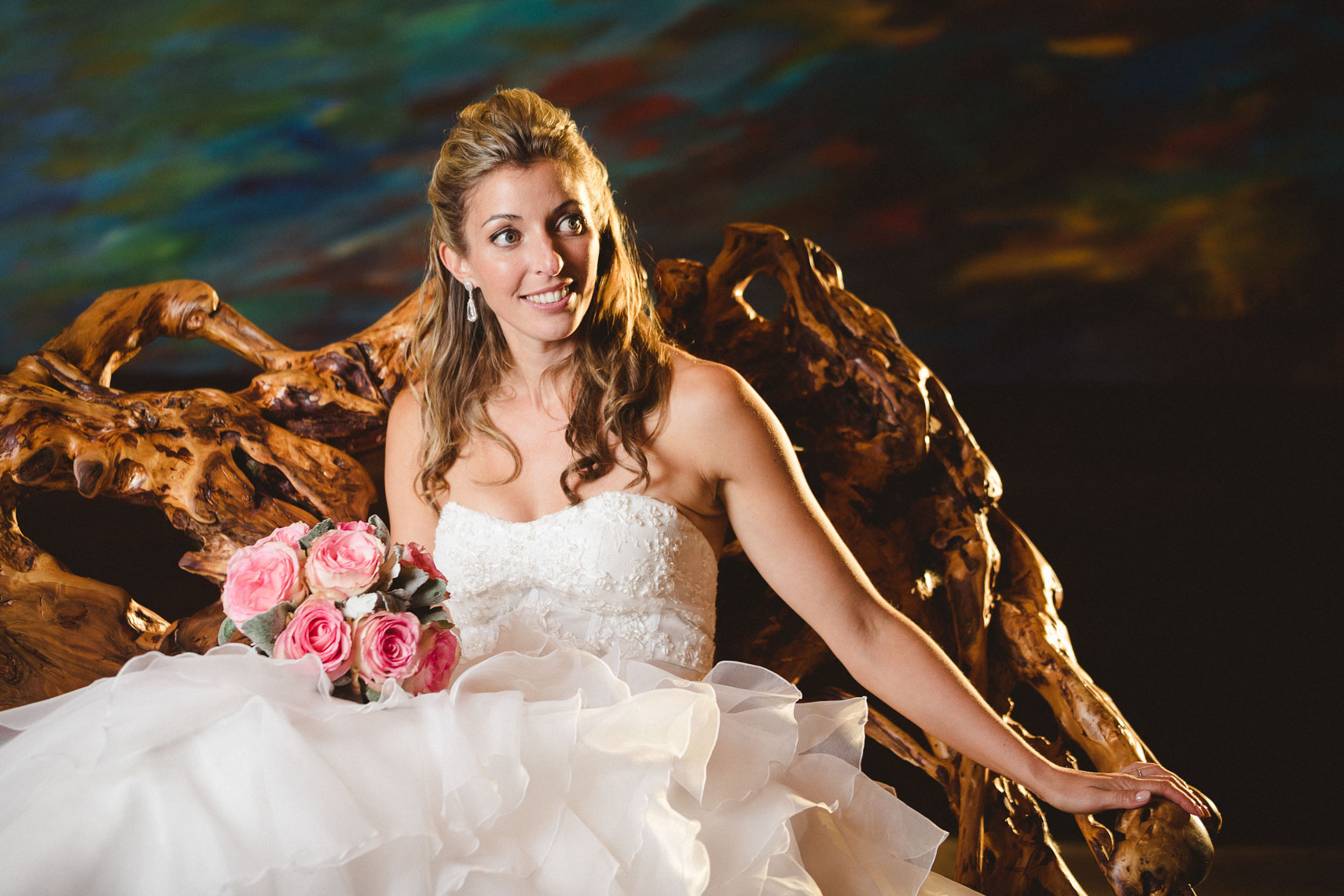 Bride sits in driftwood chair at the Whistler four seasons