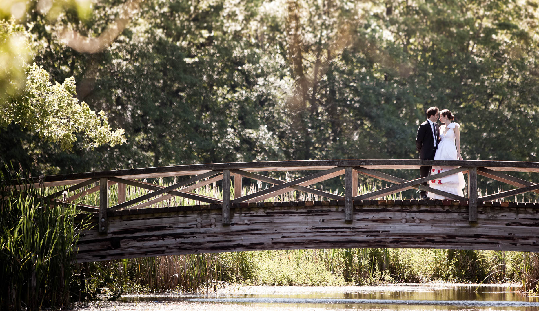 Romantic wooden bridge with bride and groom in Jericho park, Vancouver