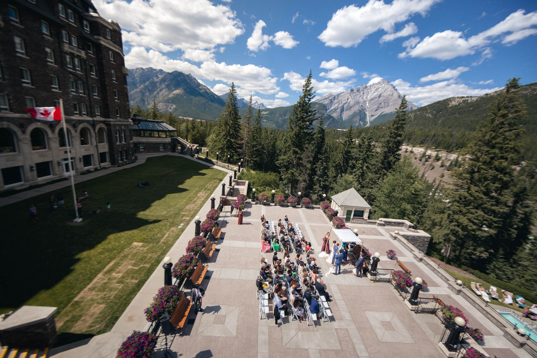 View of wedding ceremony from above at Banff Springs Hotel in Canada
