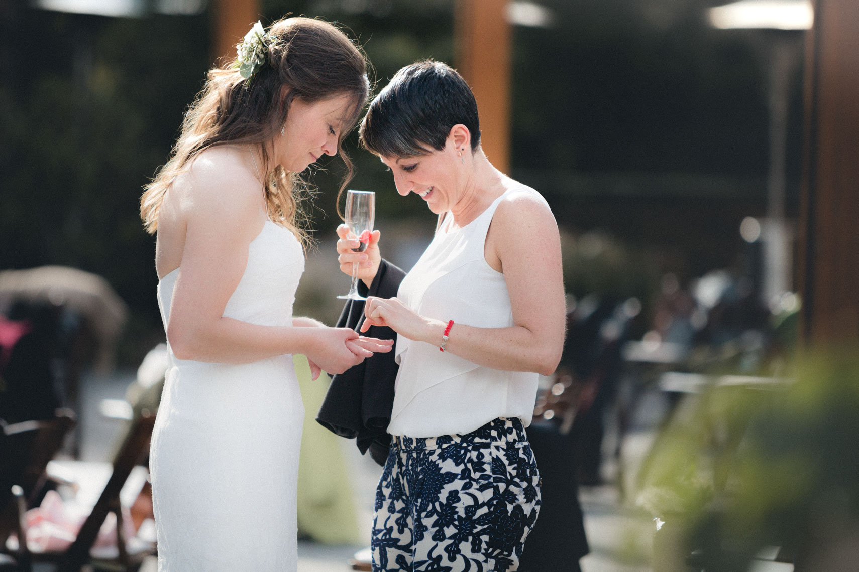 Bride chats with guests after ceremony at the SLCC venue in Whistler