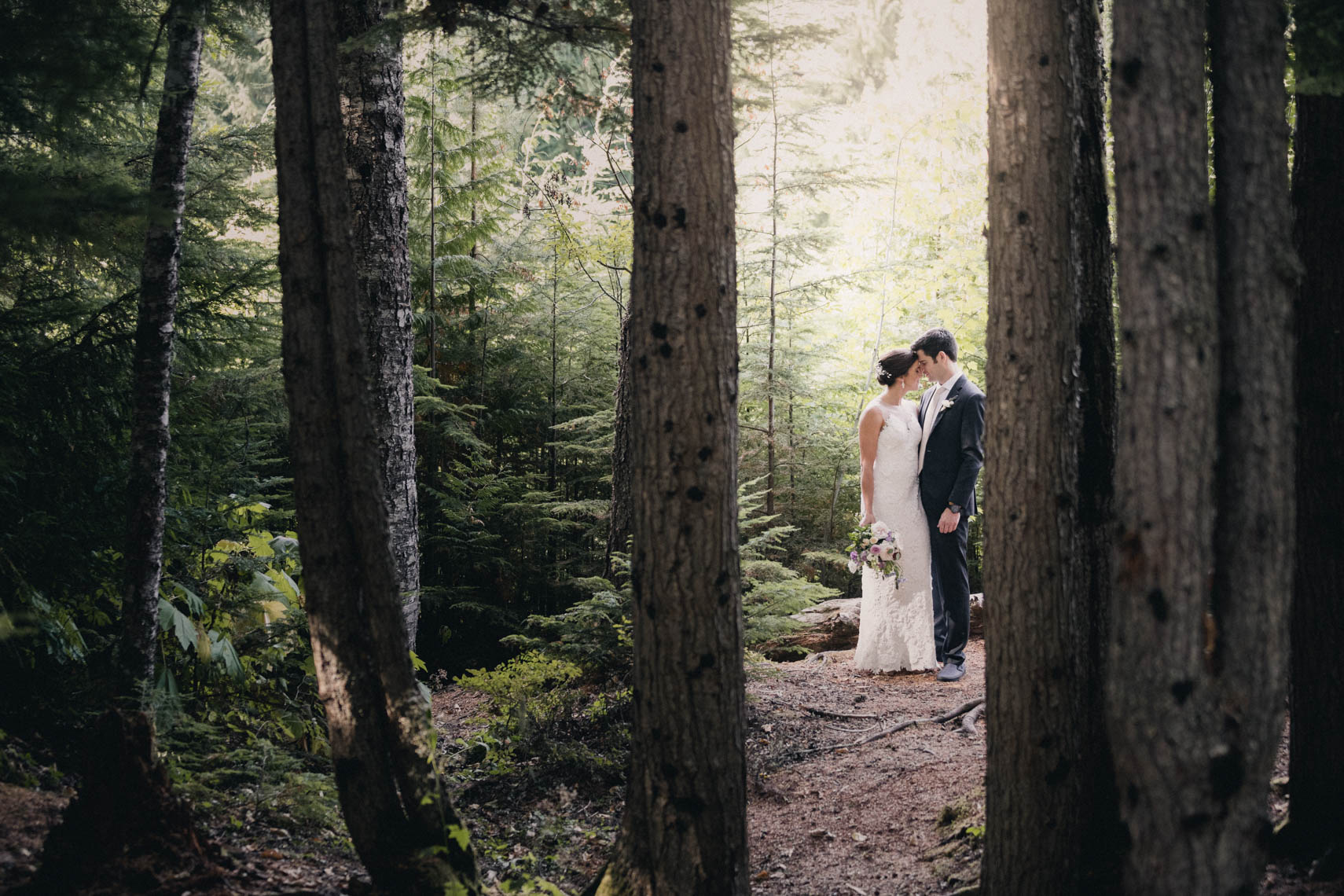 Bride and groom in the forest in Whistler, BC before their wedding