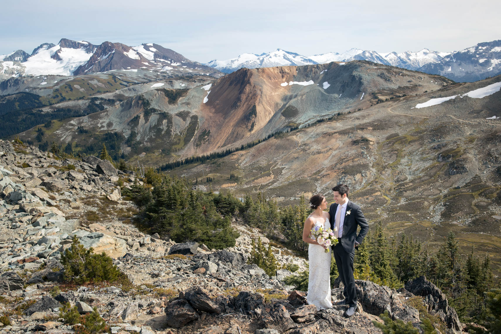Bride and groom in the mountains of whistler BC