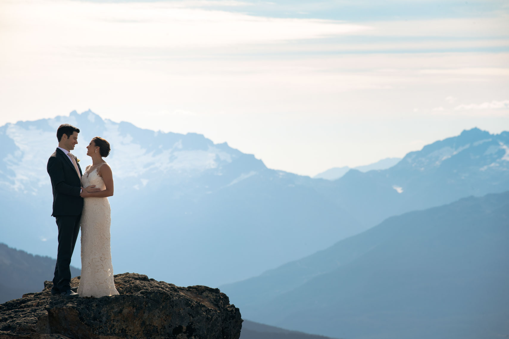Bride and groom wedding couple in the mountains of whistler blackcomb