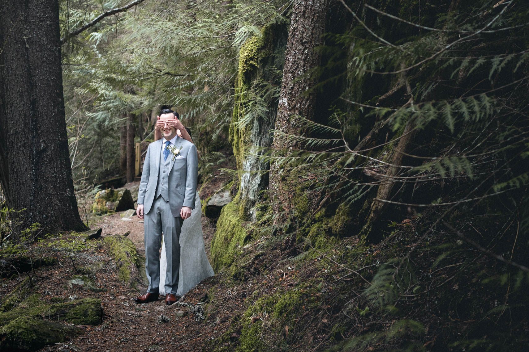 First look between bride and groom in the forest of Whistler BC