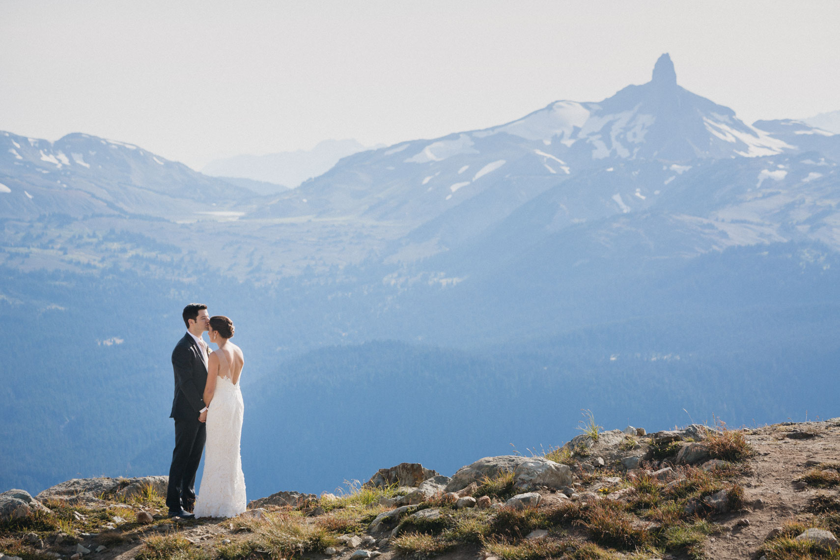 Wedding photographer from whistler shows tusk peak with bride and groom