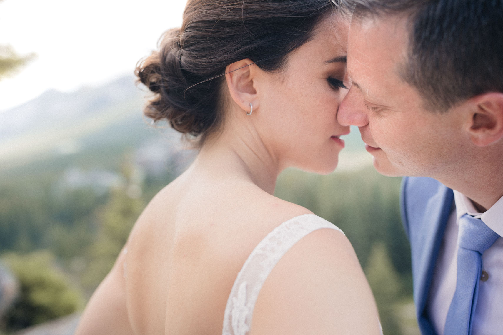 Bride and groom kiss after ceremony at Banff Springs Hotel venue in Alberta
