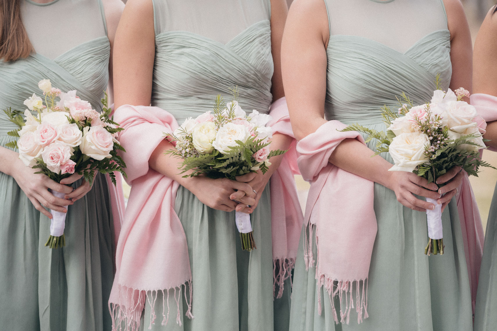 Bridesmaids dresses and bouquets during wedding in Whistler