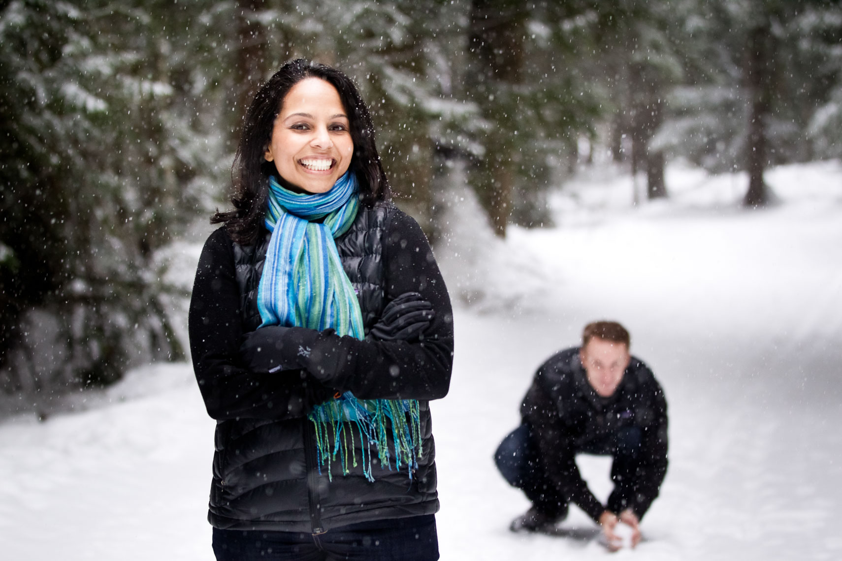 Couple on a snowy forest path before their wedding in Whistler BC