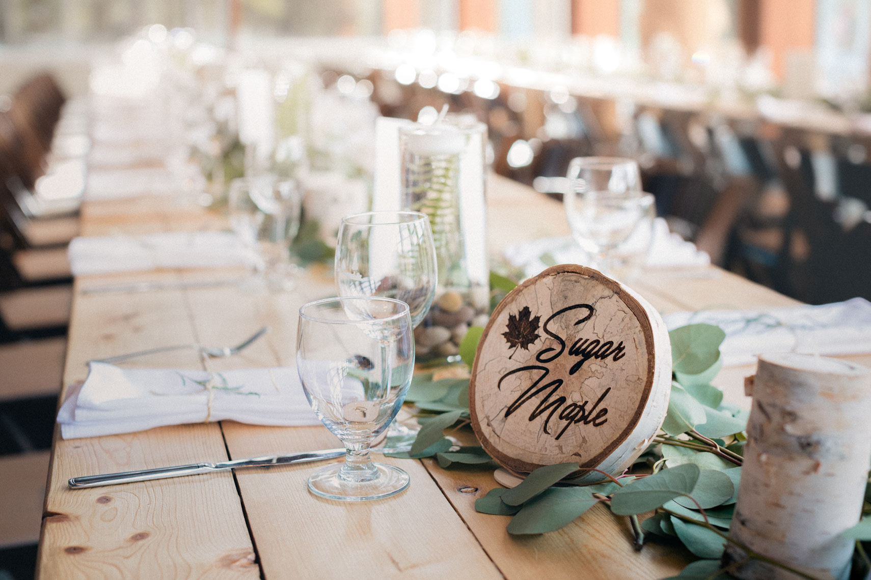 Wedding table decor photography showing natural wood sign