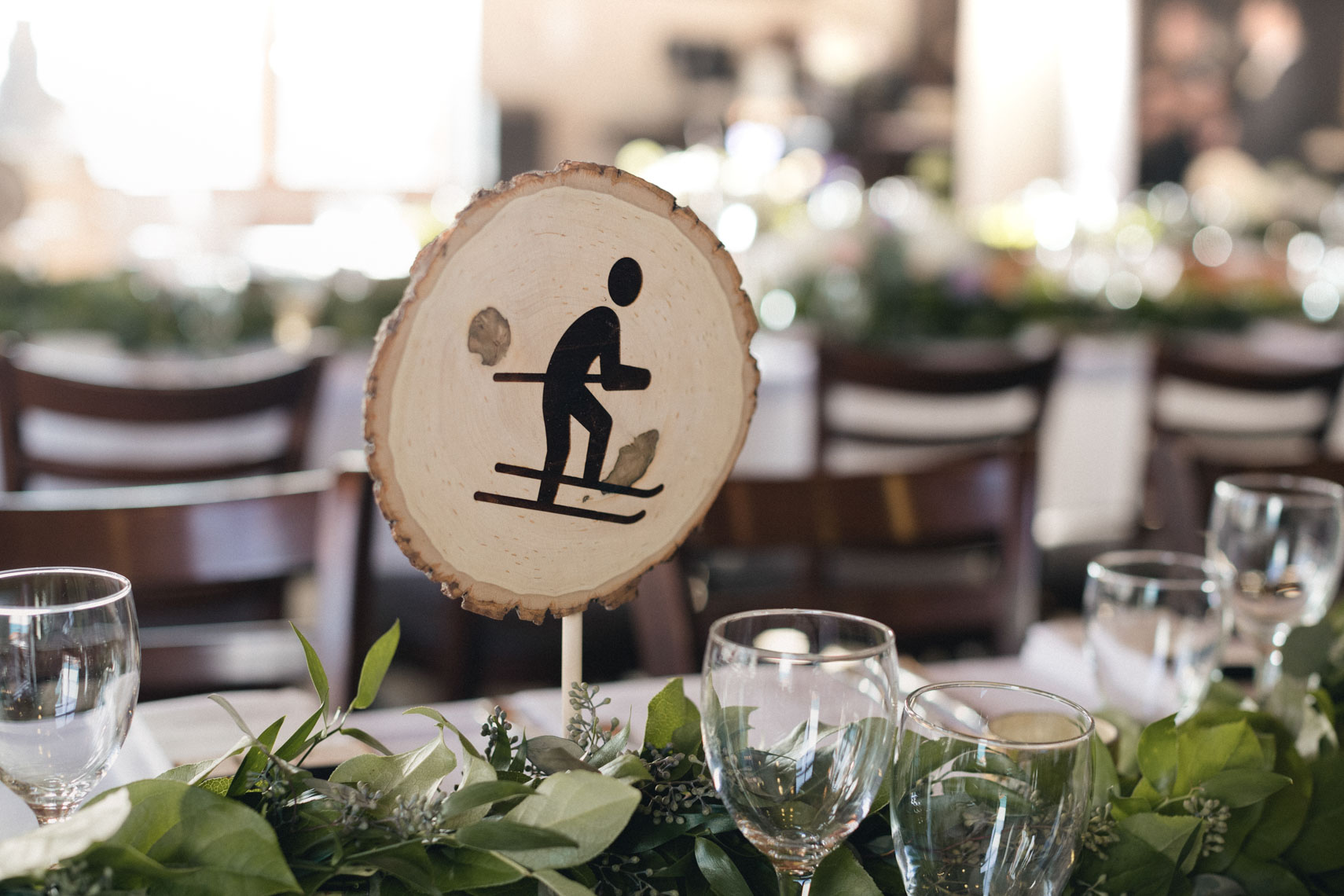 Wedding table detail of skier art in whistler bc
