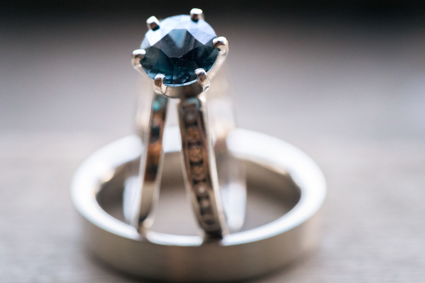 Wedding and engagement ring with blue stone macro photography