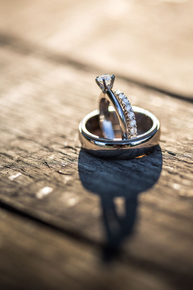 Wedding and engagement rings on natural wood in Vancouver BC