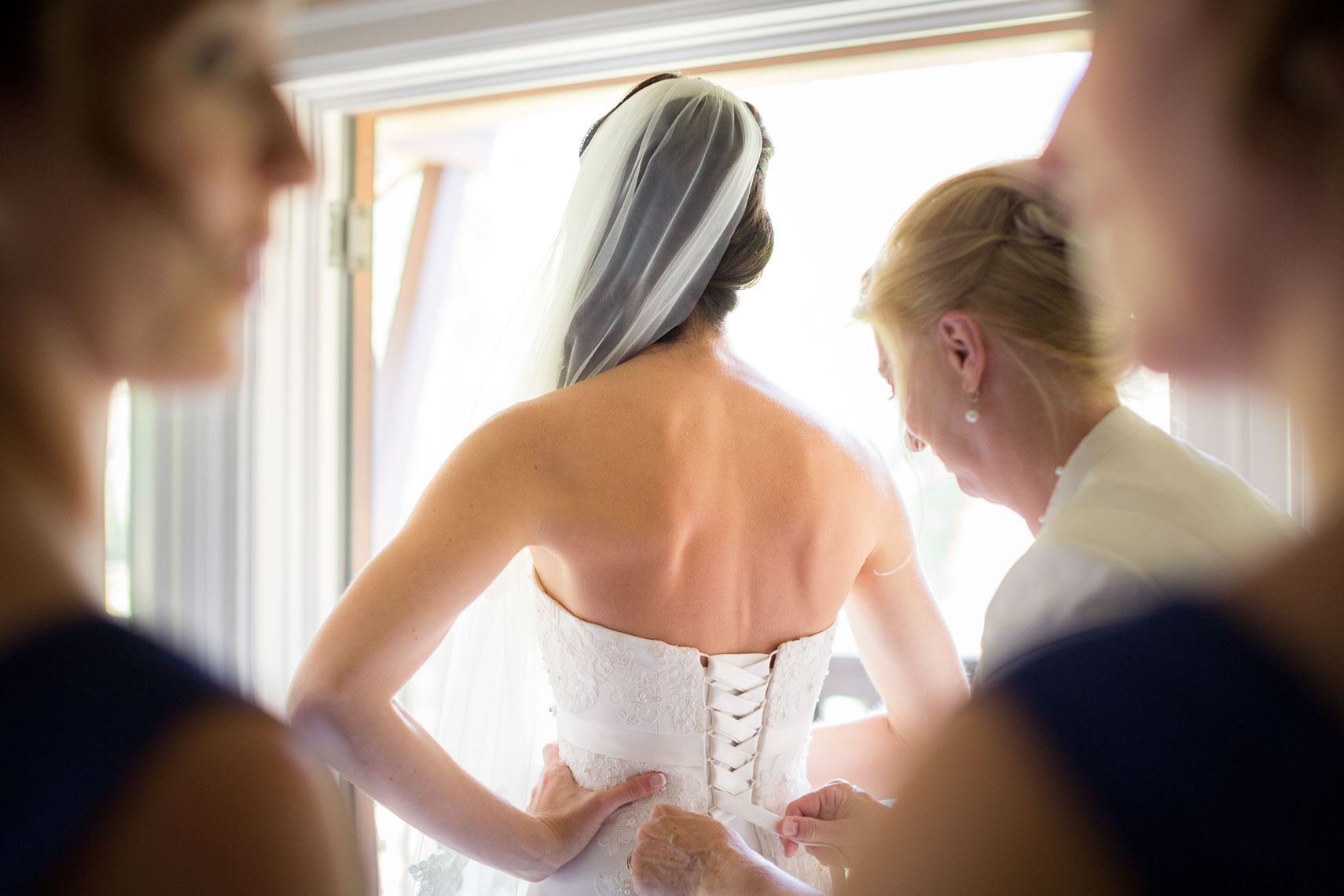 Bride getting dressed before wedding at Whistler venue