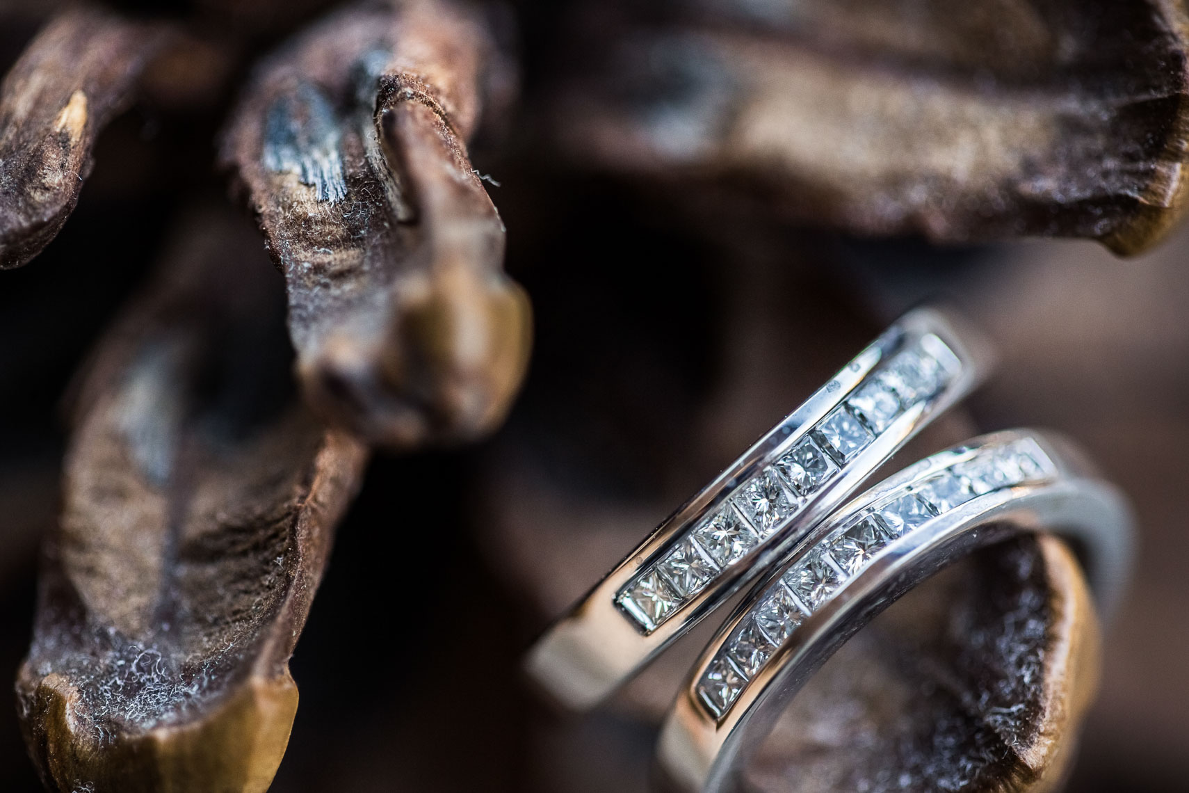 Diamond wedding ring closeup with natural driftwood