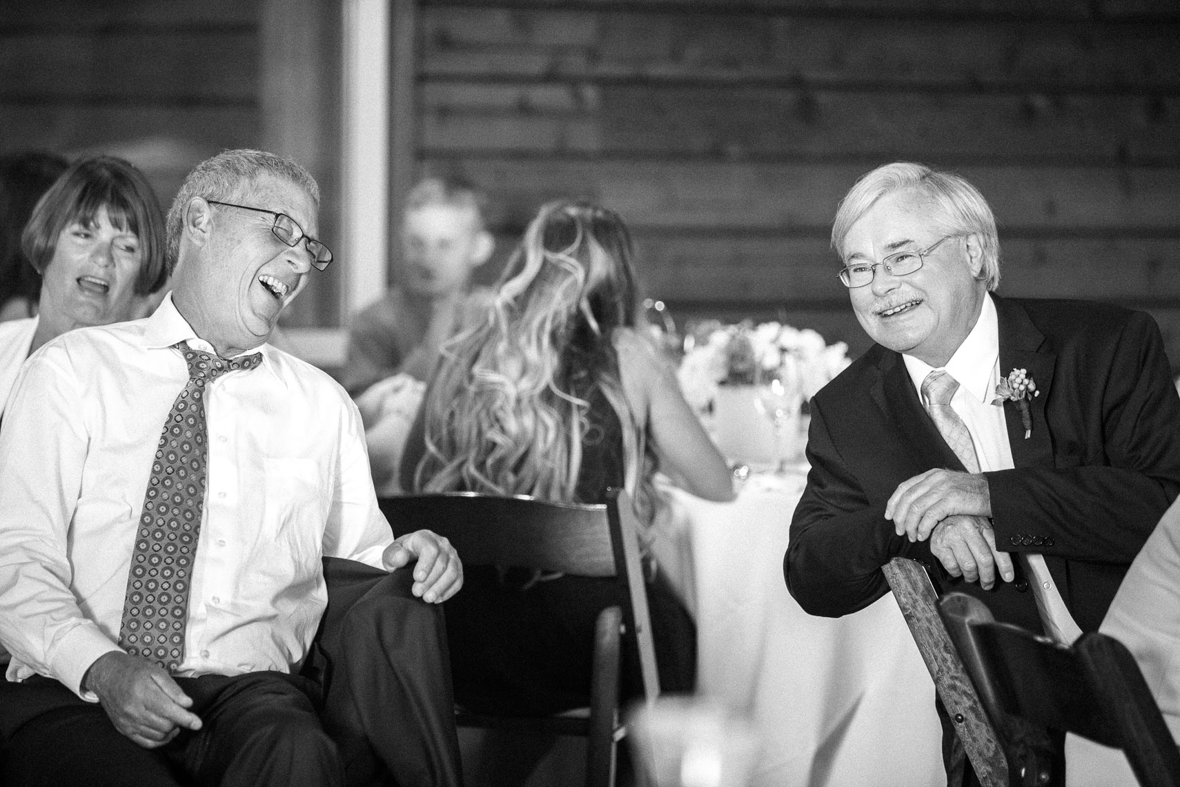 Wedding guests laugh during speeches at Whistler venue