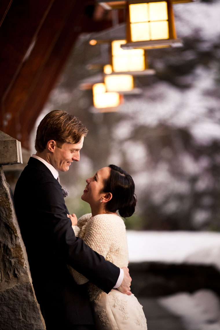 Bride and groom embrace in candid moment before wedding at Nita Lake Lodge