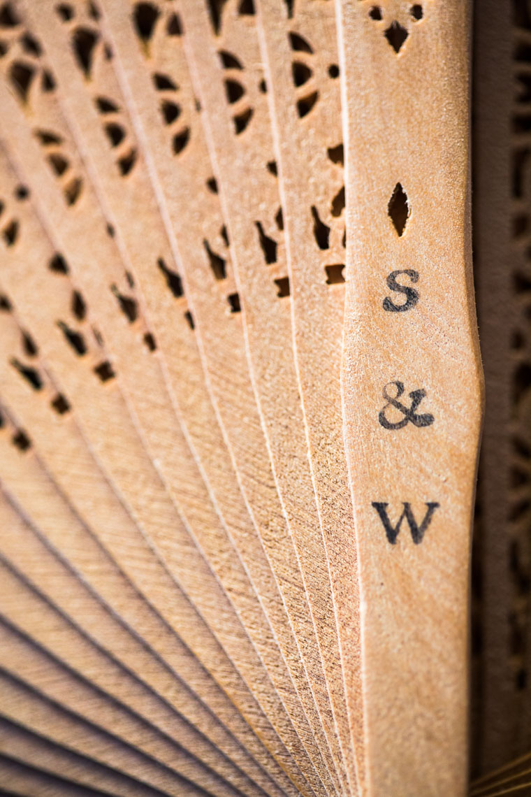 Wooden fan wedding memento at destination wedding