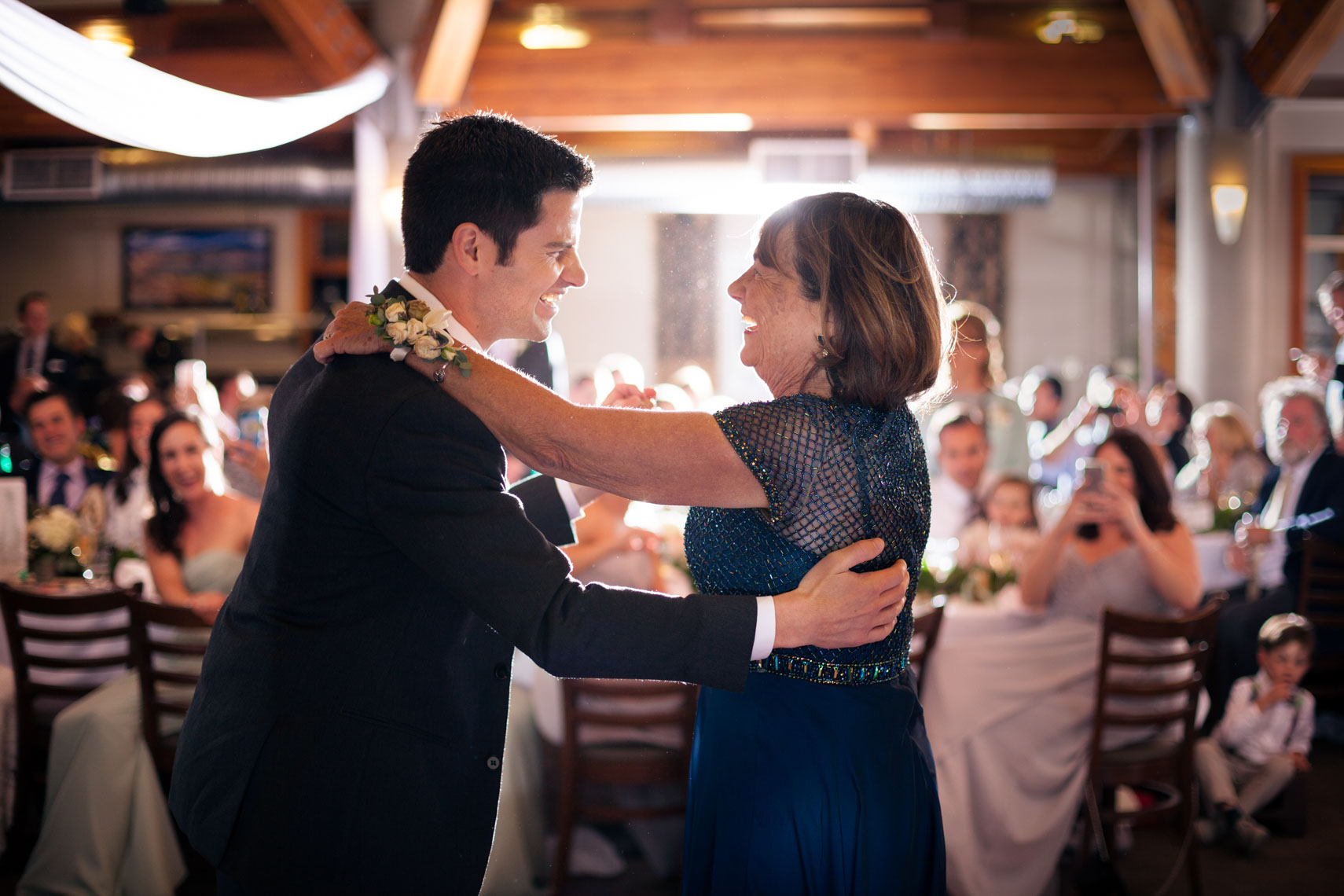 Groom and mother dance during wedding reception at roundhouse lodge