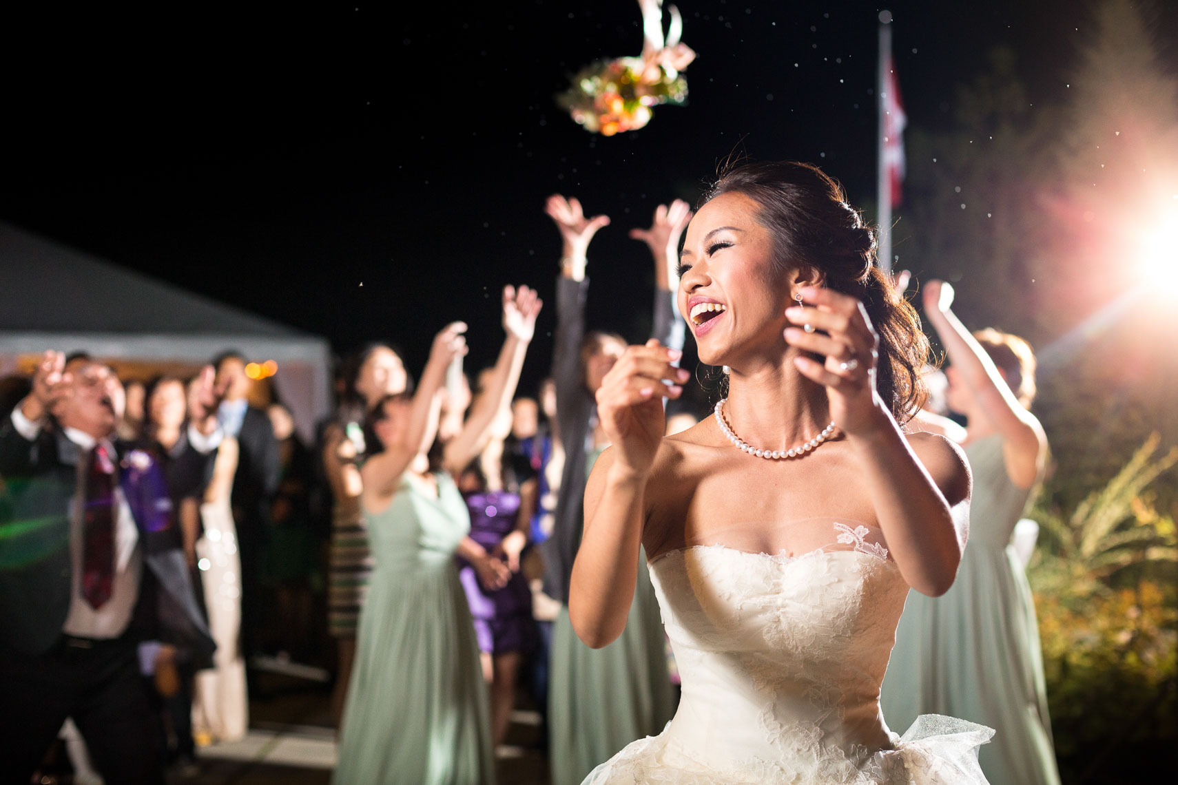 Bride throws the bouquet at nicklaus north wedding venue in Whistler BC