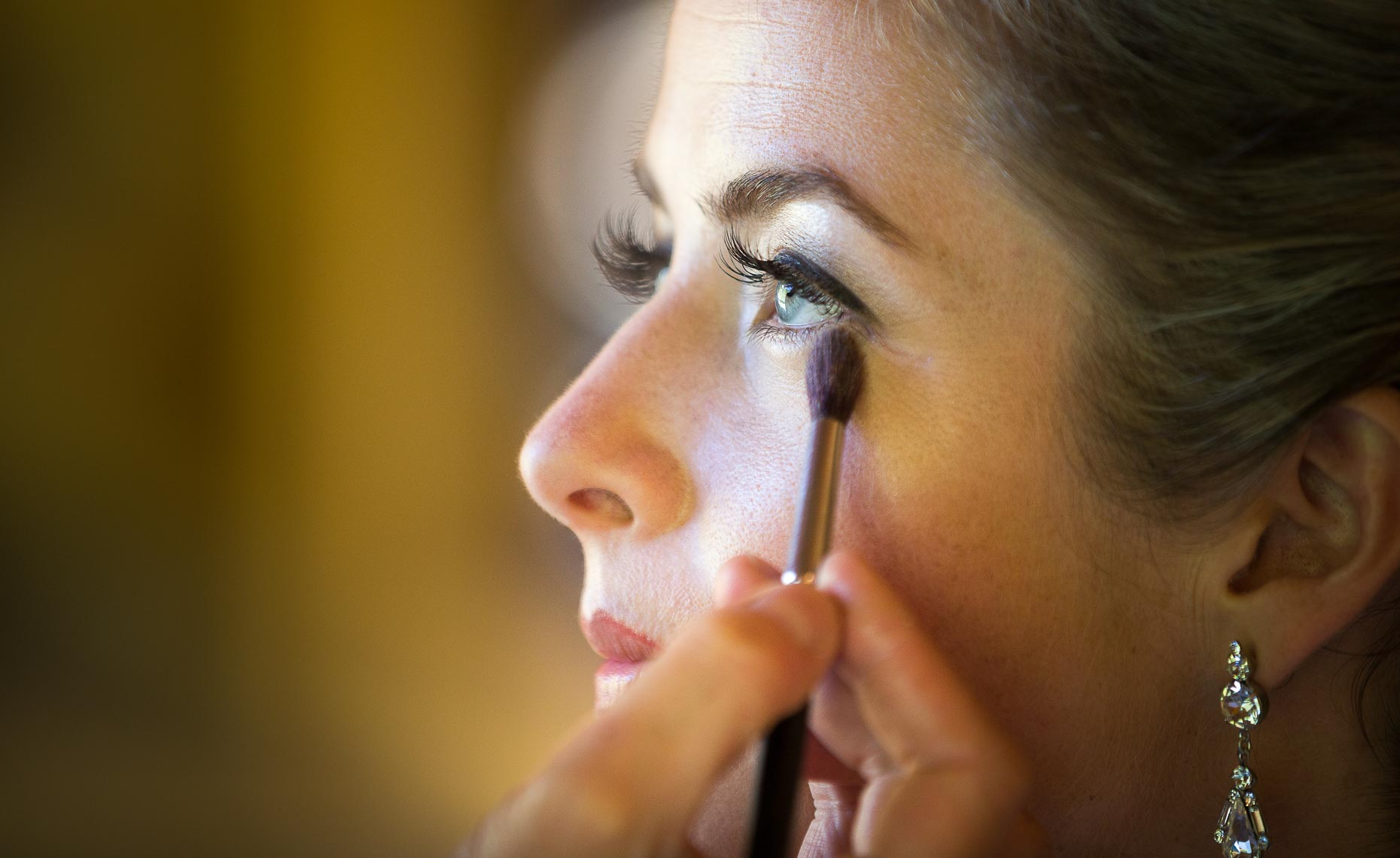 Bride getting ready with makeup from Whistler wedding photographer Robin O