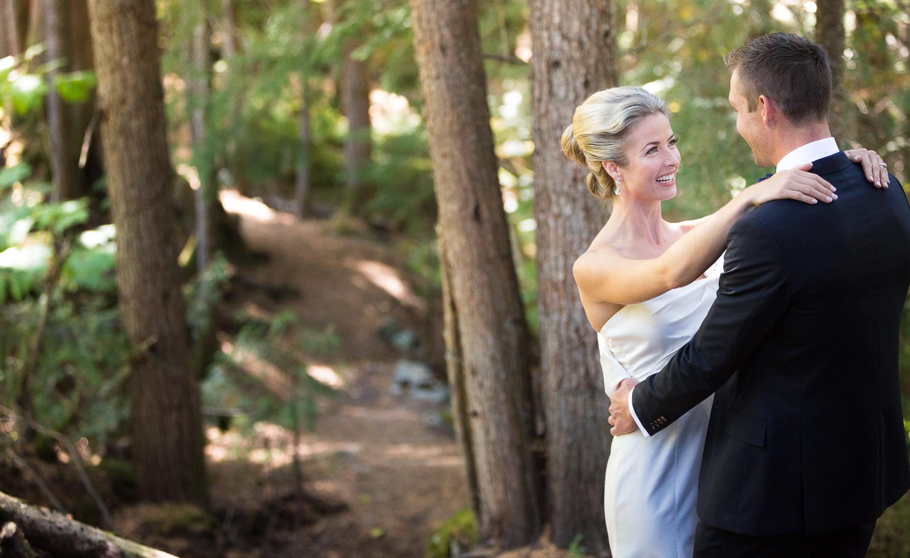 Bride and groom in the whistler woods