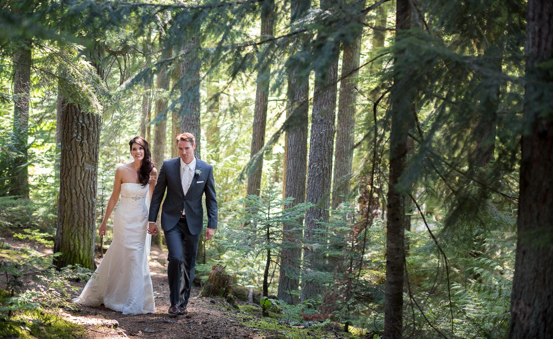 wilderness adventure wedding couple walking in the forest