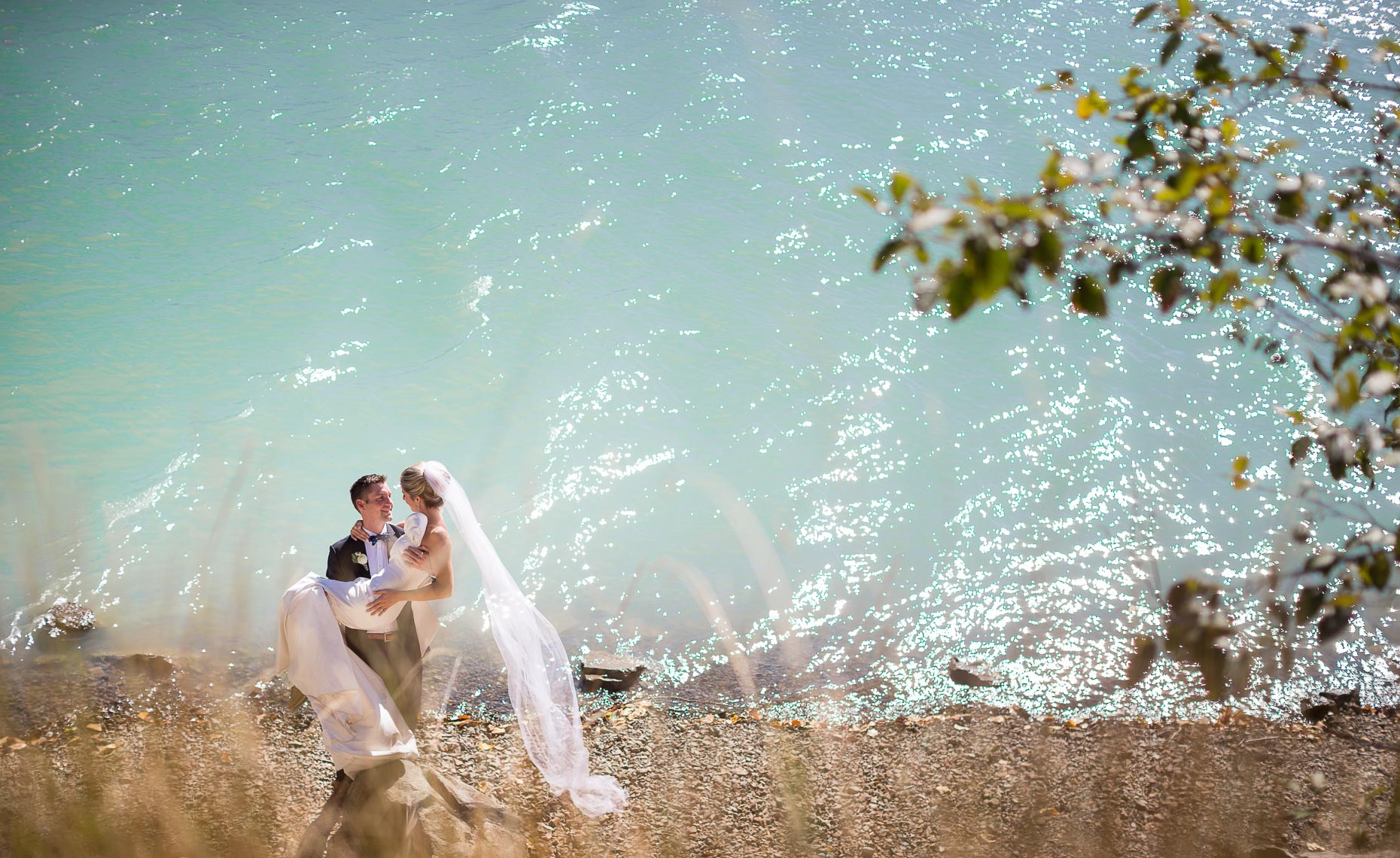 Turquoise lake water in romantic whistler wedding couple portrait