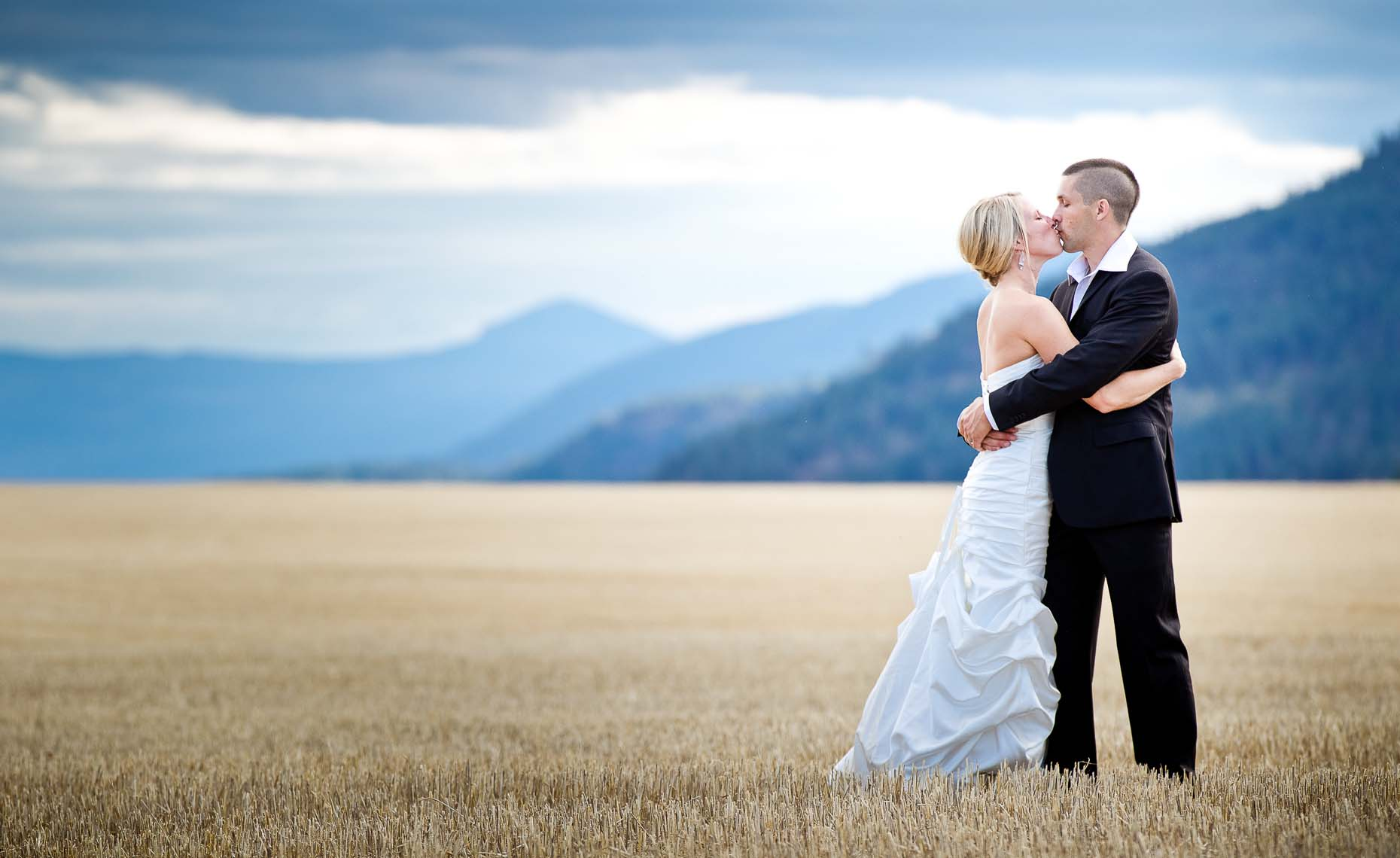 whistler wedding couple in pemberton field with mountains