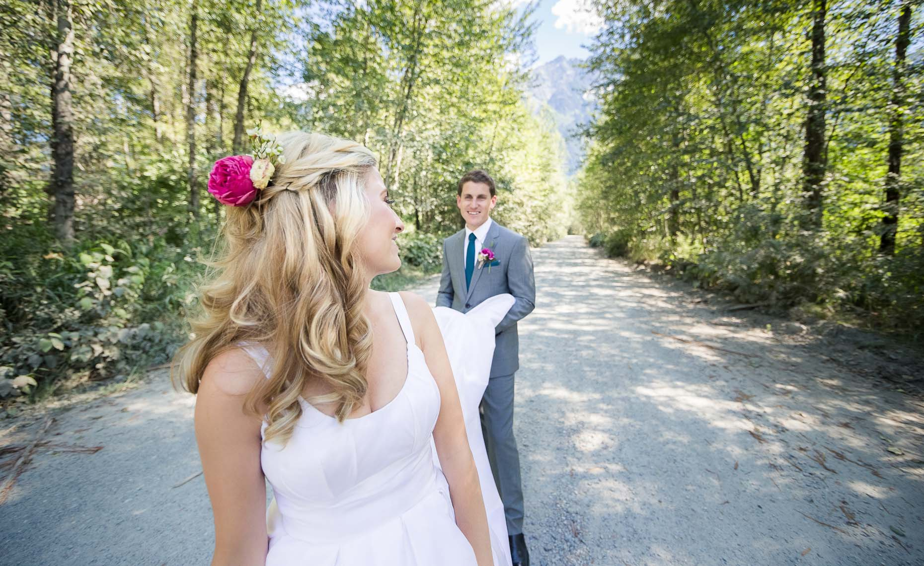 First look in the trees before whistler wedding ceremony.