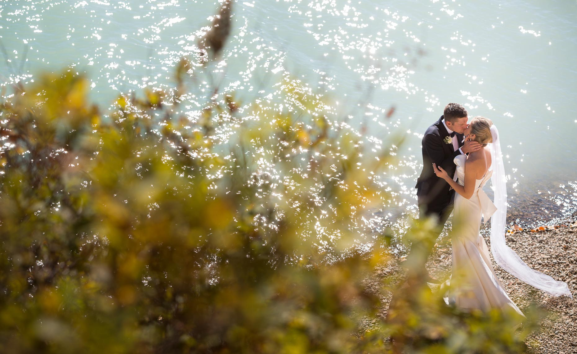 Intimate lakeside moment for wedding couple in Whistler