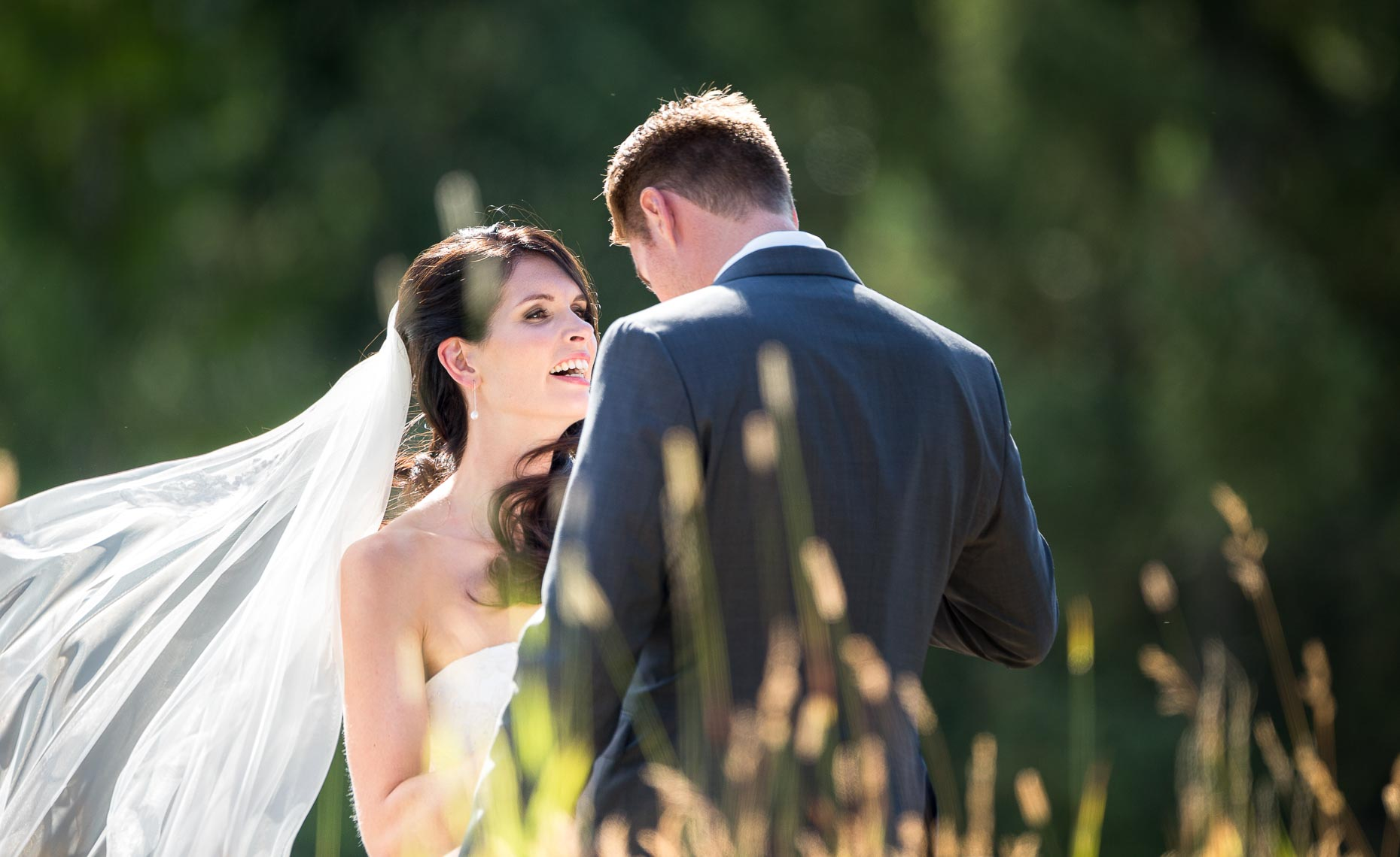 Intimate moment between bride and groom during wedding in Whistler, Canada