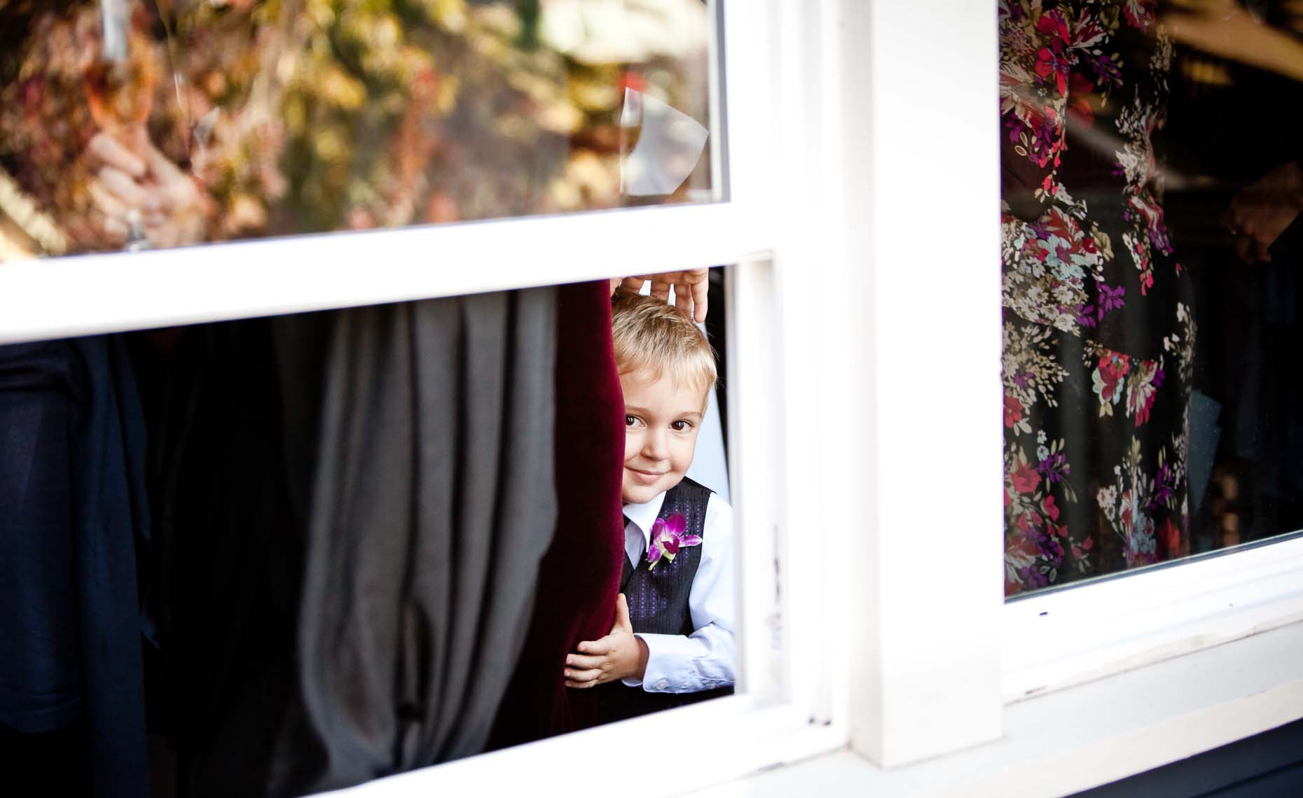 Boy at vancouver wedding peeks at camera