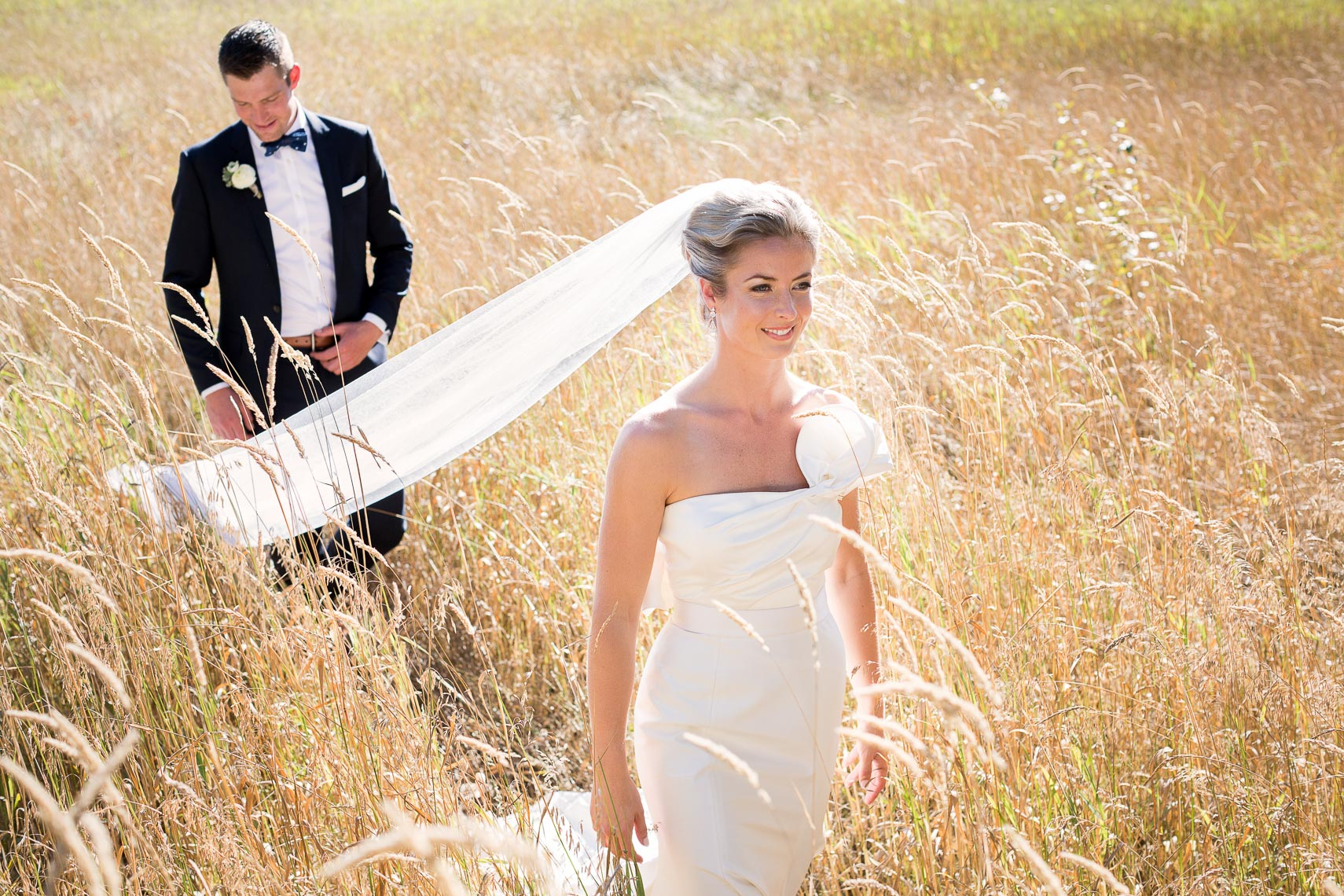 Bride and groom in a field in whistler wedding photo