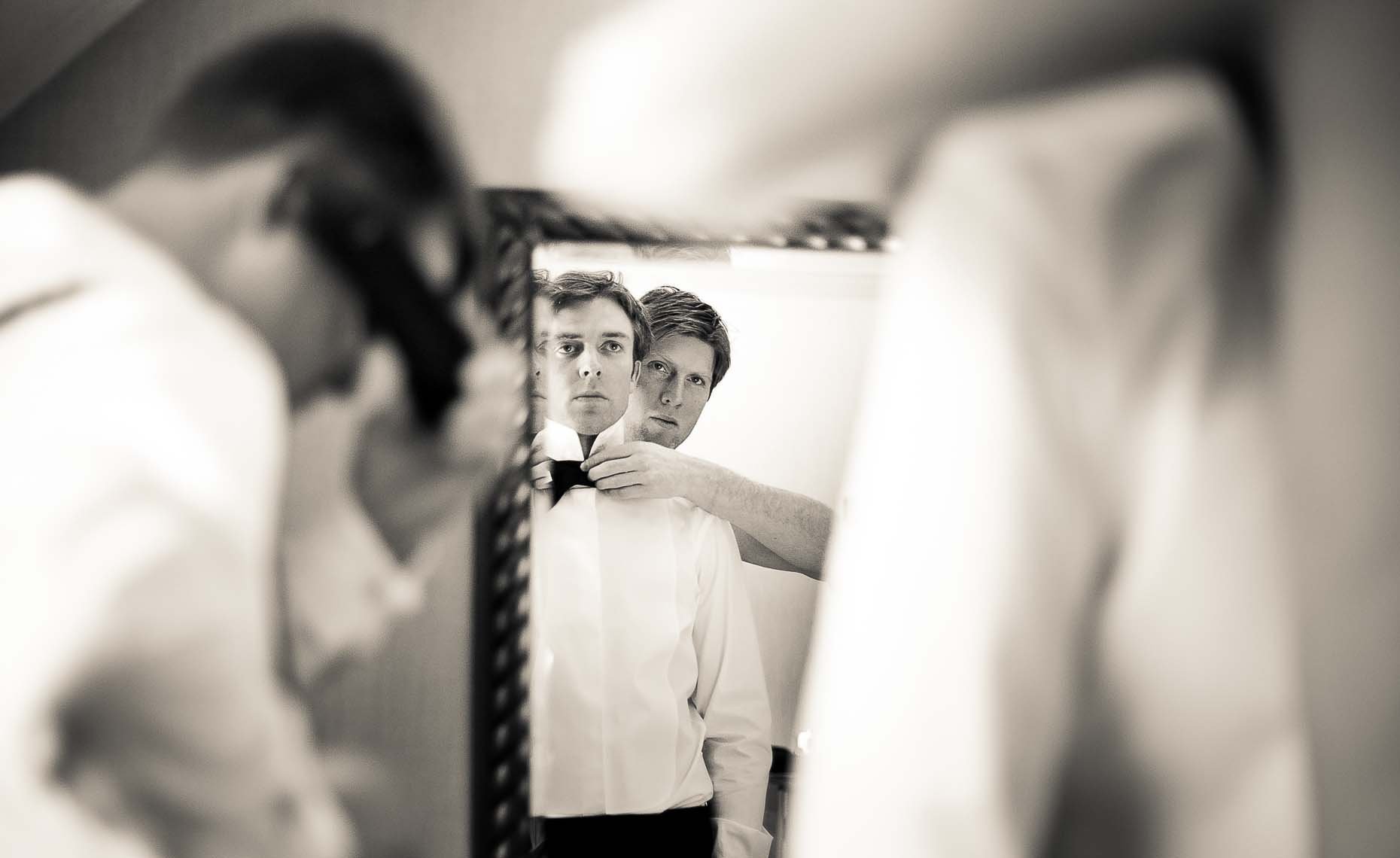 Groom and groomsmen getting ready before Whistler wedding ceremony