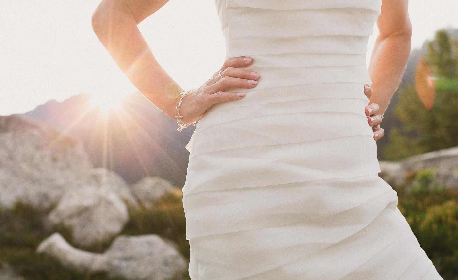 wedding dress with sun flare outdoor adventure wedding photography in whistler