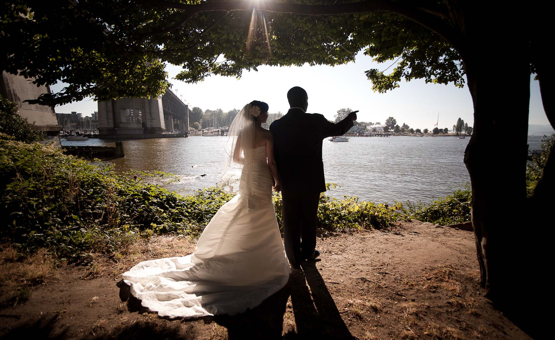 silhouette of vancouver wedding couple by burrard inlet