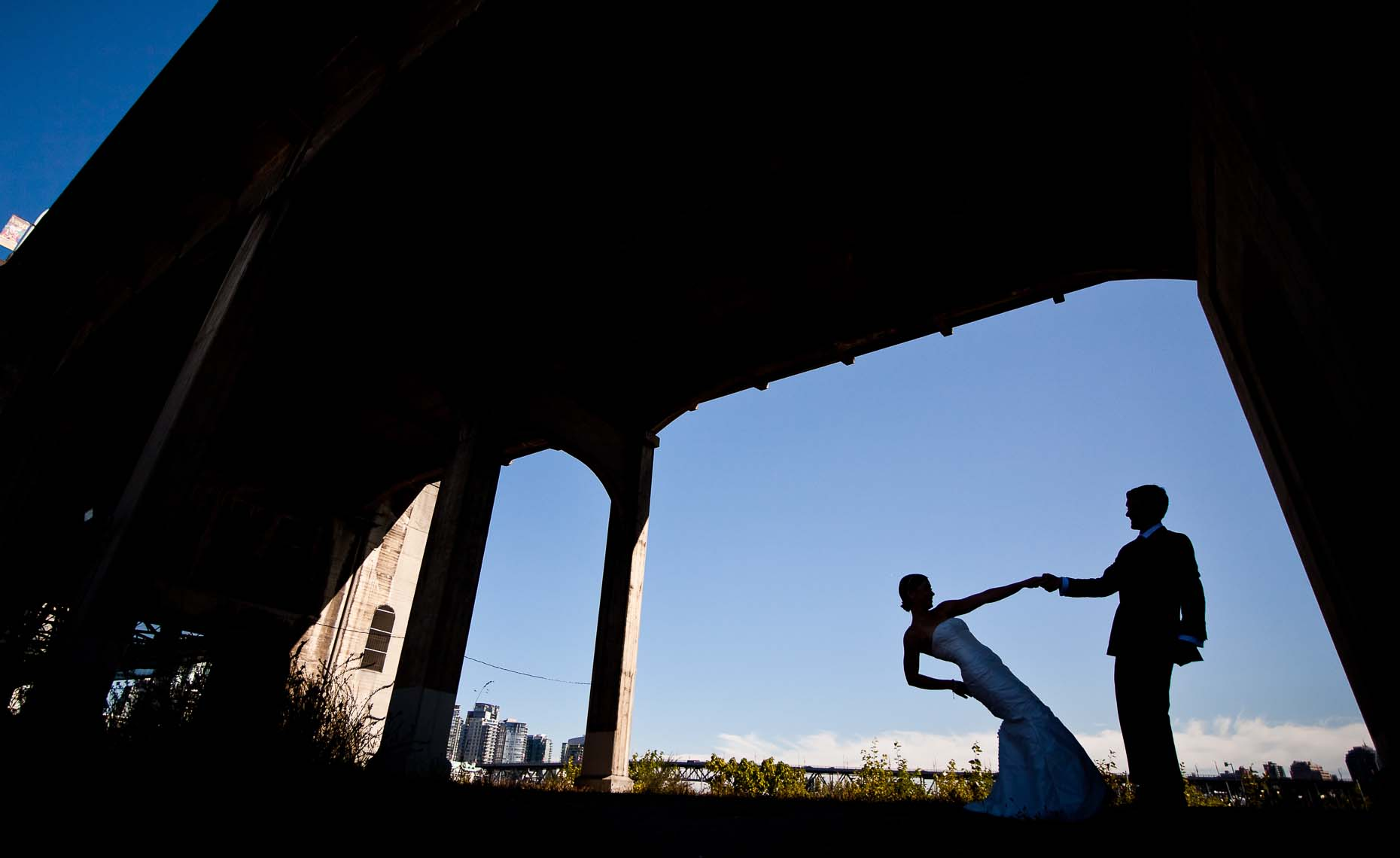vancouver wedding photography silhouette under burrard bridge
