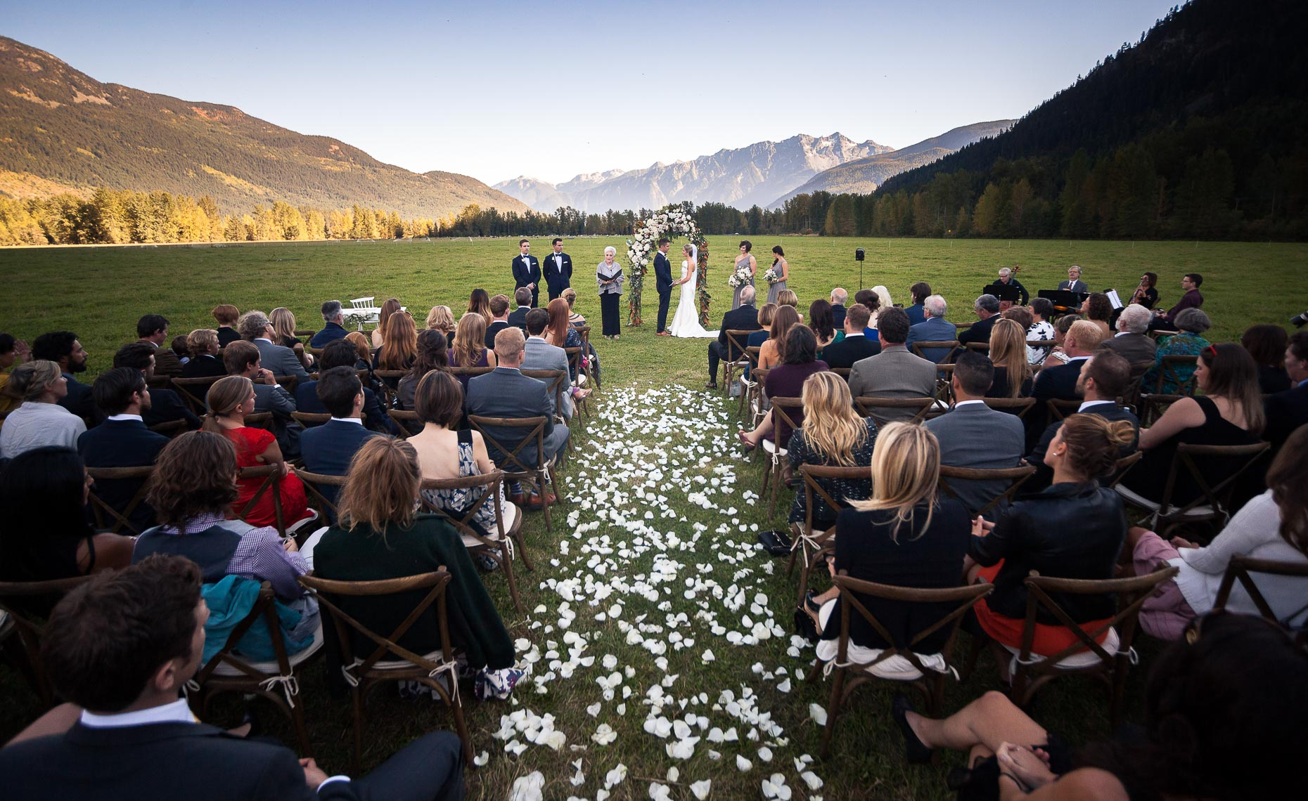 Wideangle wedding shot of farm wedding in Pemberton with mountains