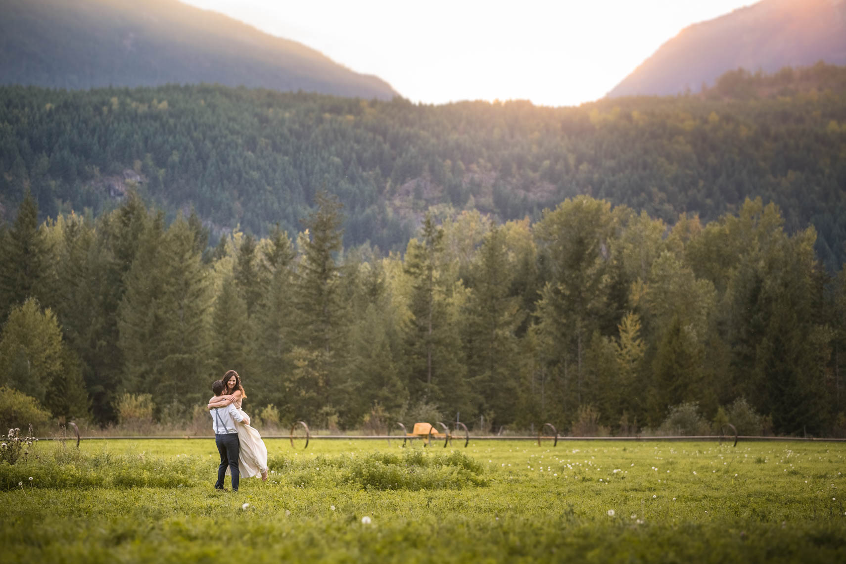 Landscape shot of couple at rustic vintage style Whistler farm wedding