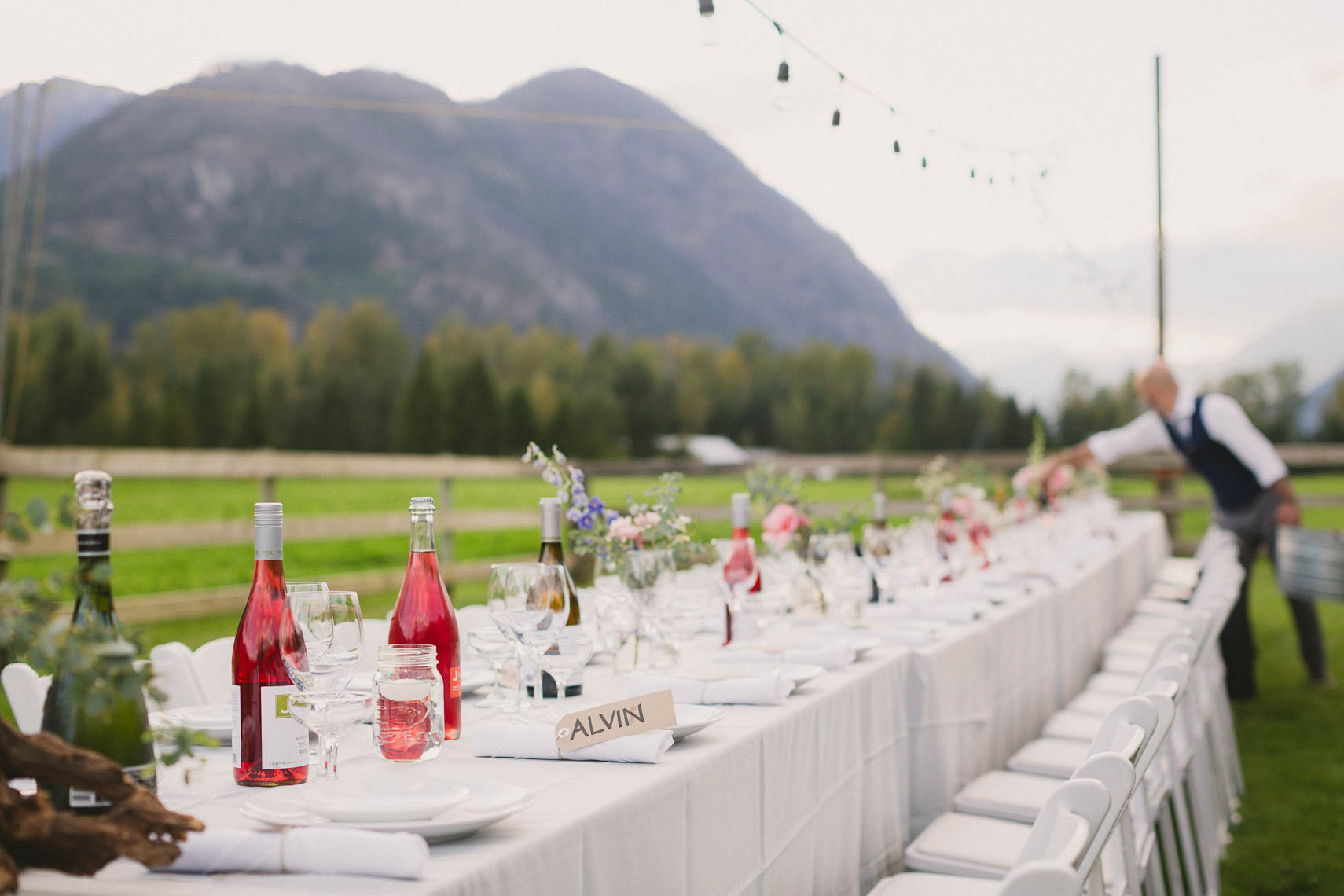 Outdoor wedding table setup at farm reception near Whistler, BC.