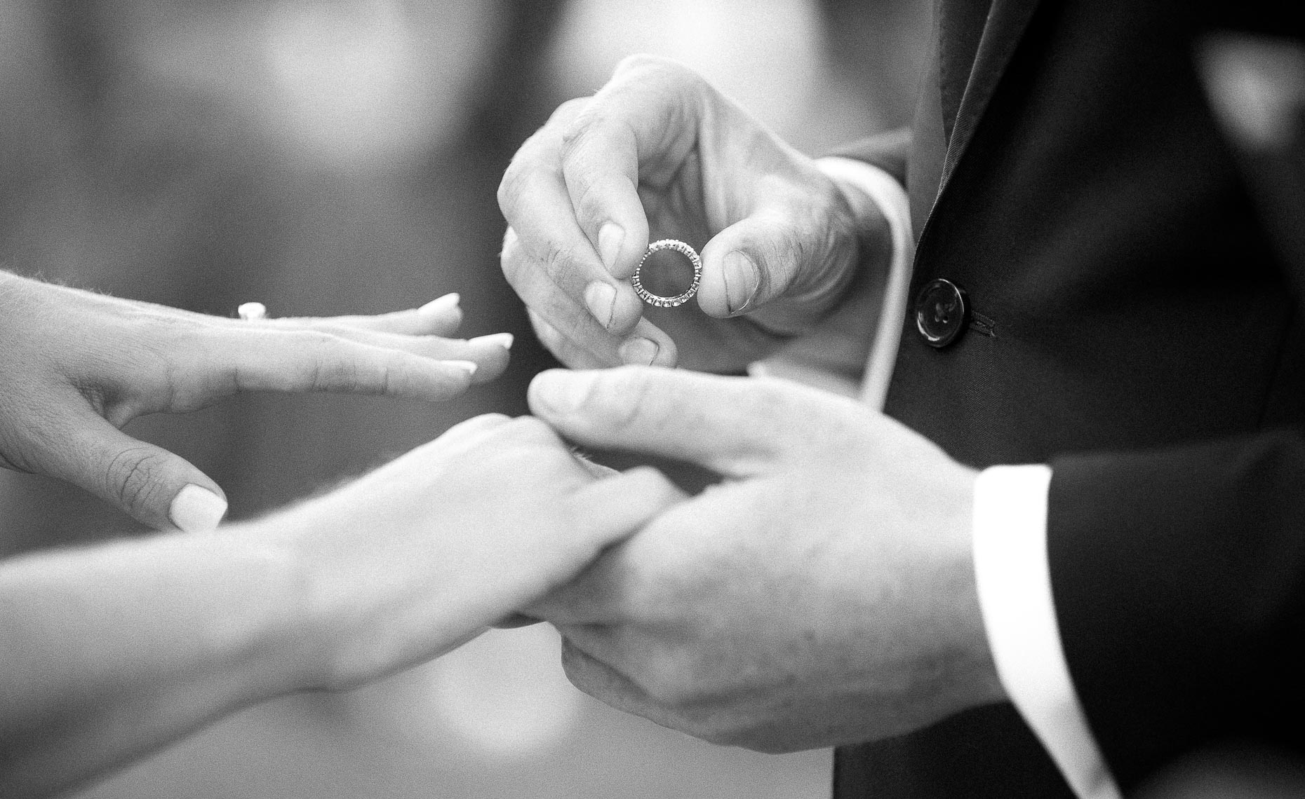 Black and white wedding photography closeup of ring during ceremony in Whistler