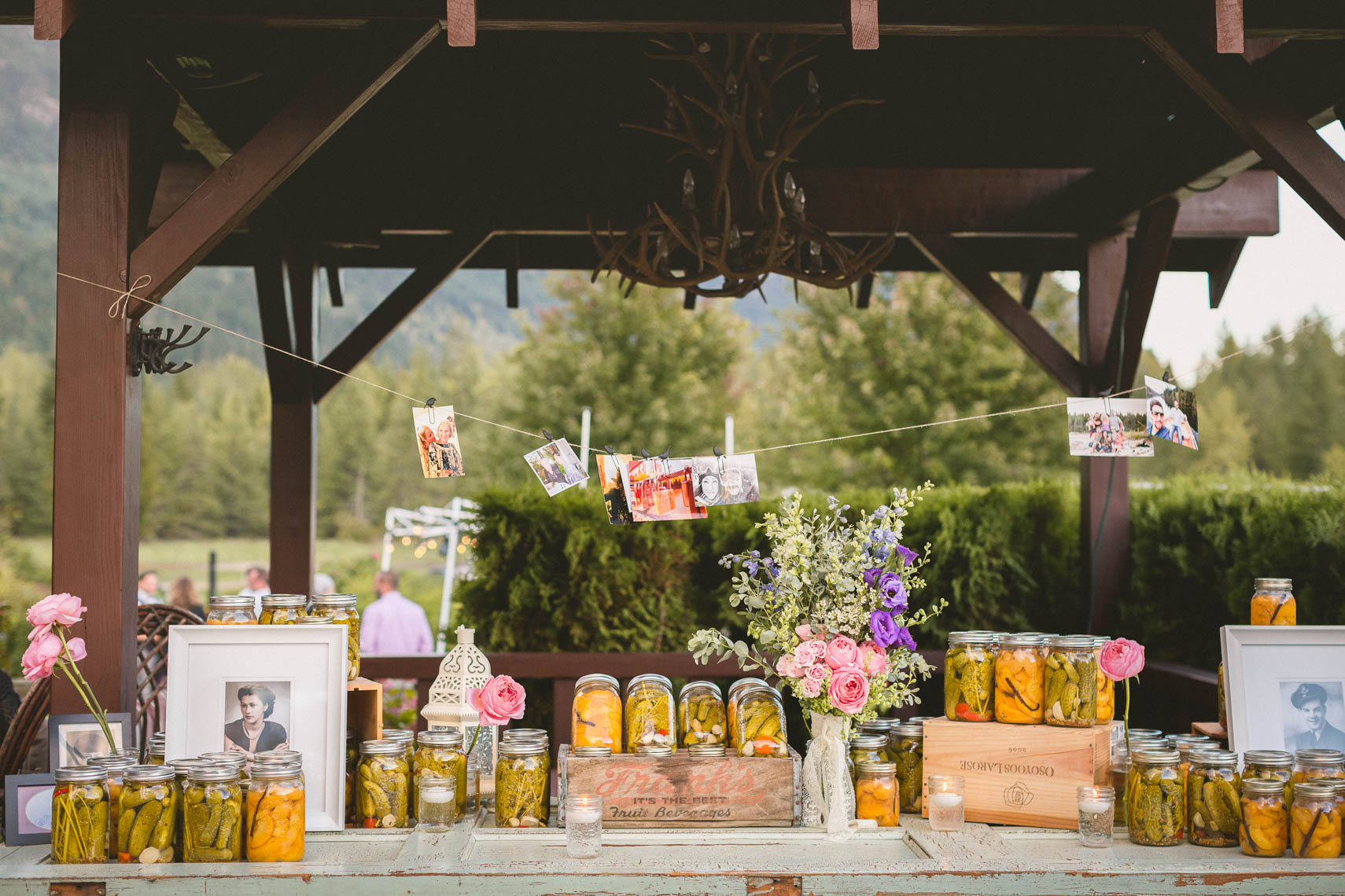 Closeup of jarred preserves at outdoor rustic farm wedding near Whistler, BC.