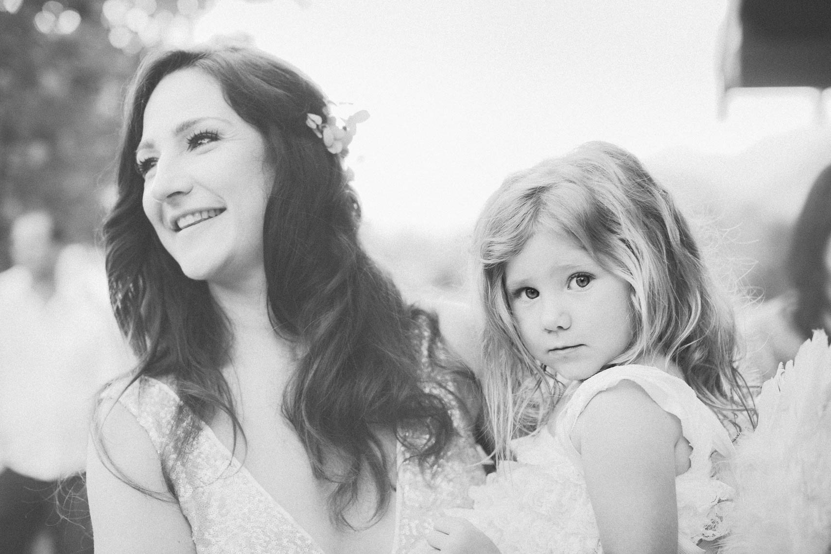 Bride with child in black and white portrait at wedding reception