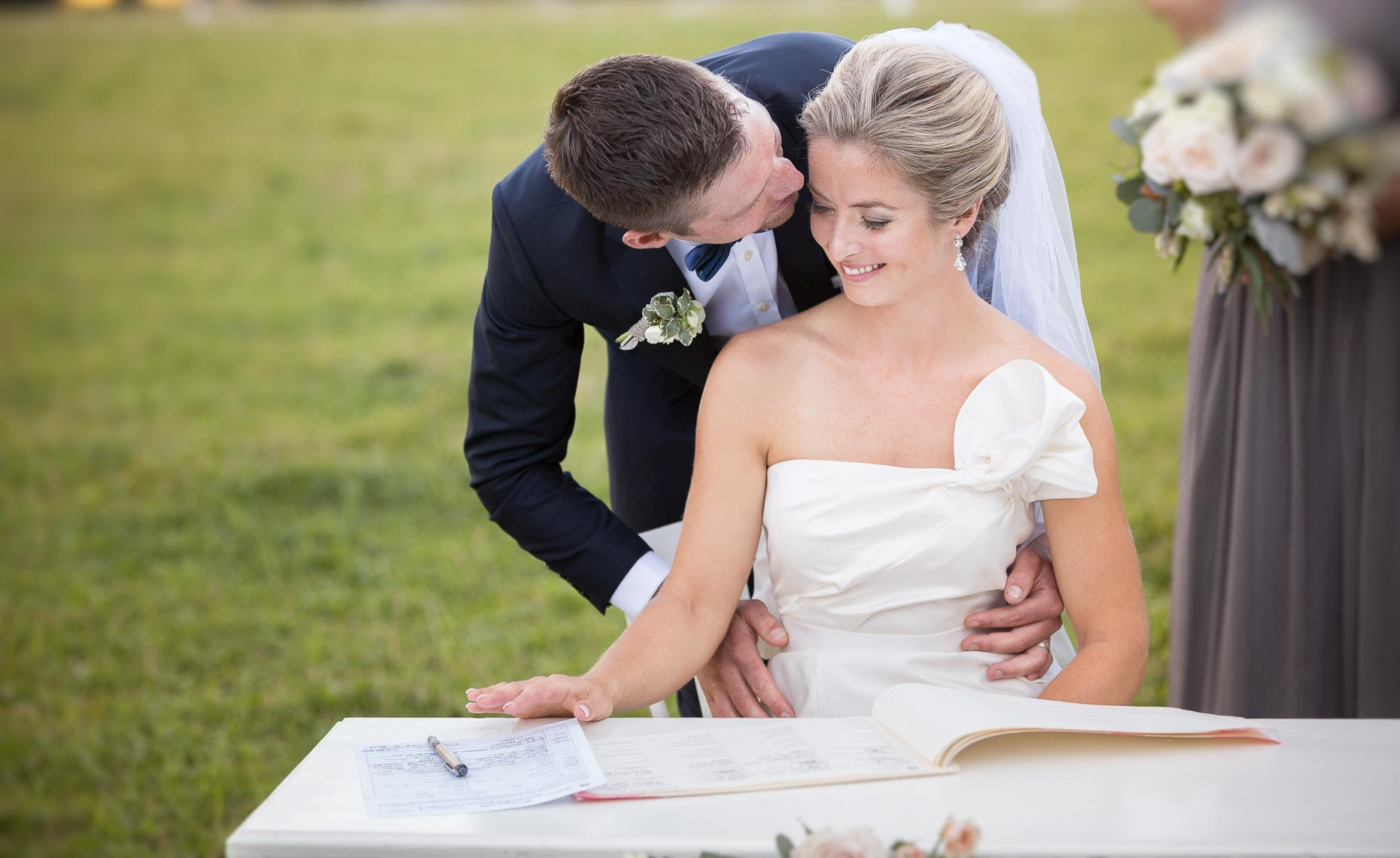 Bride and groom signing wedding registry in Whistler, BC