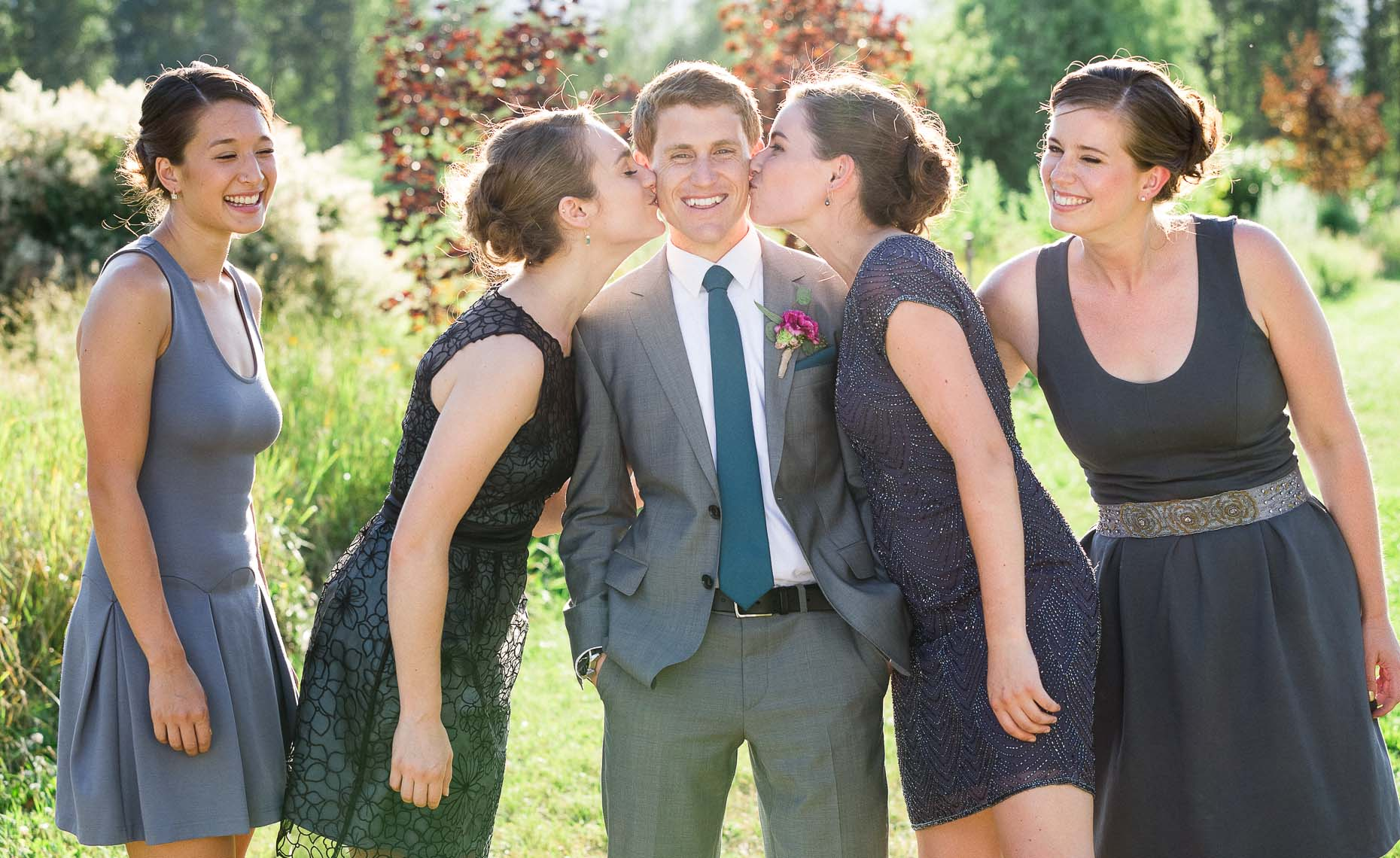 Groom and bridesmaids at rustic vintage style Whistler wedding.
